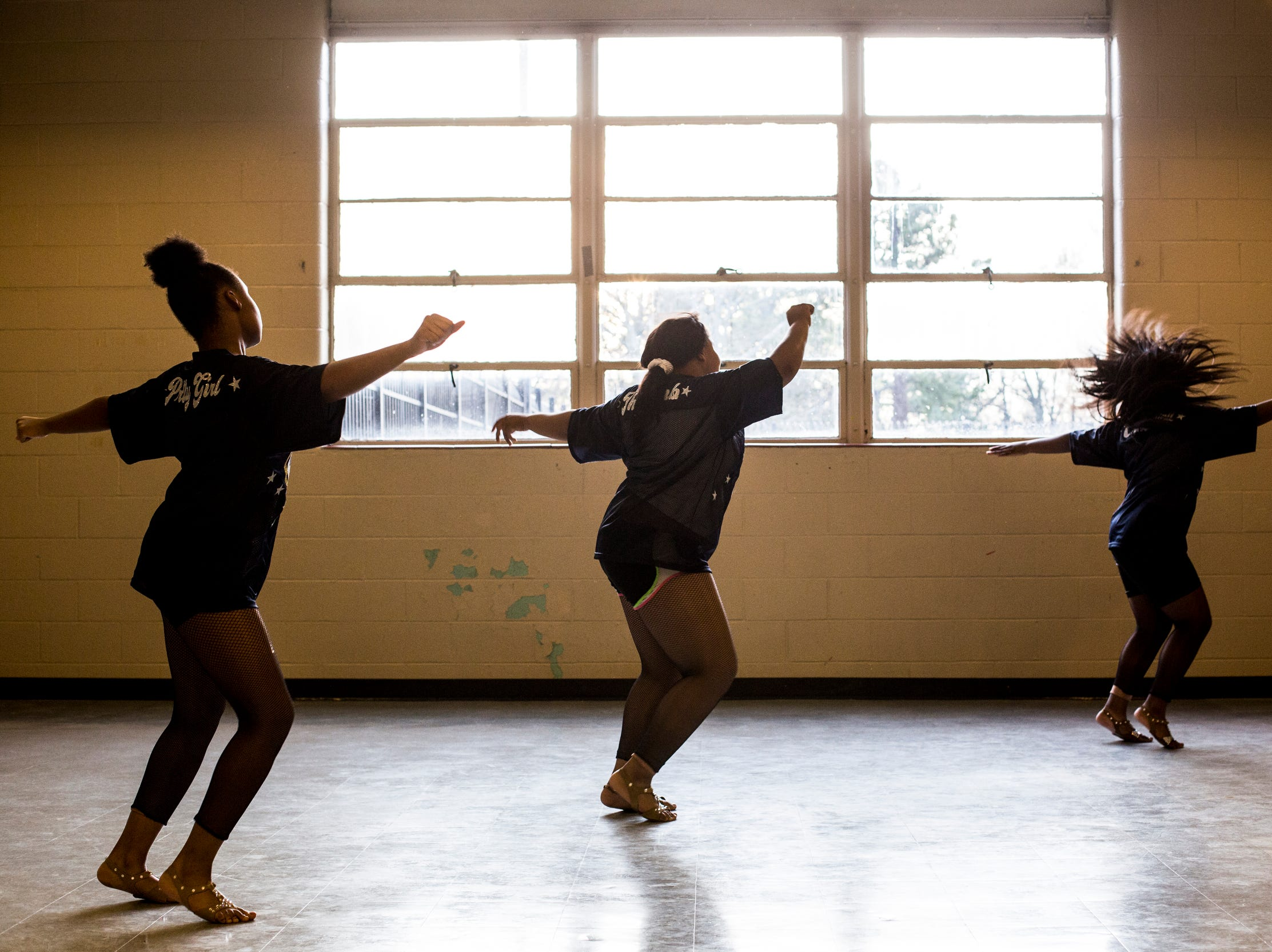 Members of the Memphis Community Youth Mighty Marchers, from left, Angel Mitchell, 12, LaNordia Fletcher, 13, and Maya Cole, 17, work on their dance moves during a practice at the Ed Rice Community Center in Frayser on March 28, 2019.