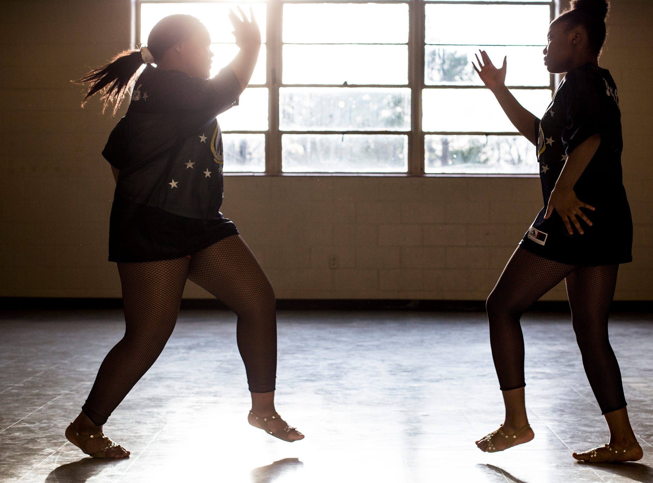 Members of the Memphis Community Youth Mighty Marchers, from left, LaNordia Fletcher, 13, and Angel Mitchell, 12, work on their dance moves during a practice at the Ed Rice Community Center in Frayser on March 28, 2019.