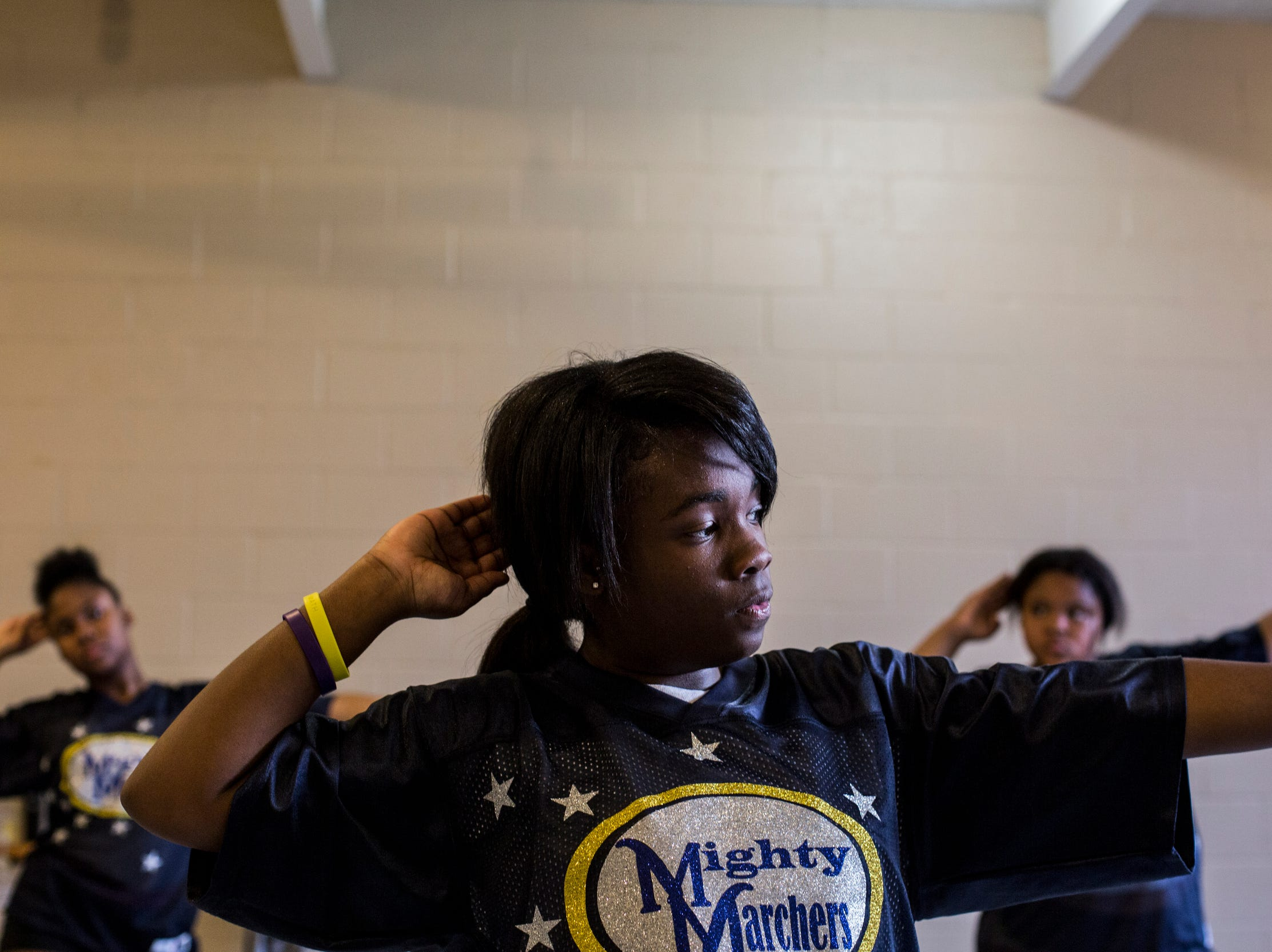 Maya Cole, 17, dances along with other members of the Memphis Community Youth Mighty Marchers during a practice at the Ed Rice Community Center in Frayser on March 28, 2019.