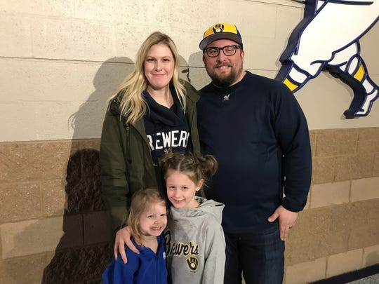 The Labodda family, Jessica, Michael, 4-year-old Libby and 6-year-old Lola; became a hit with their sign asking Christian Yelich for a home run so they'd get a new pup.