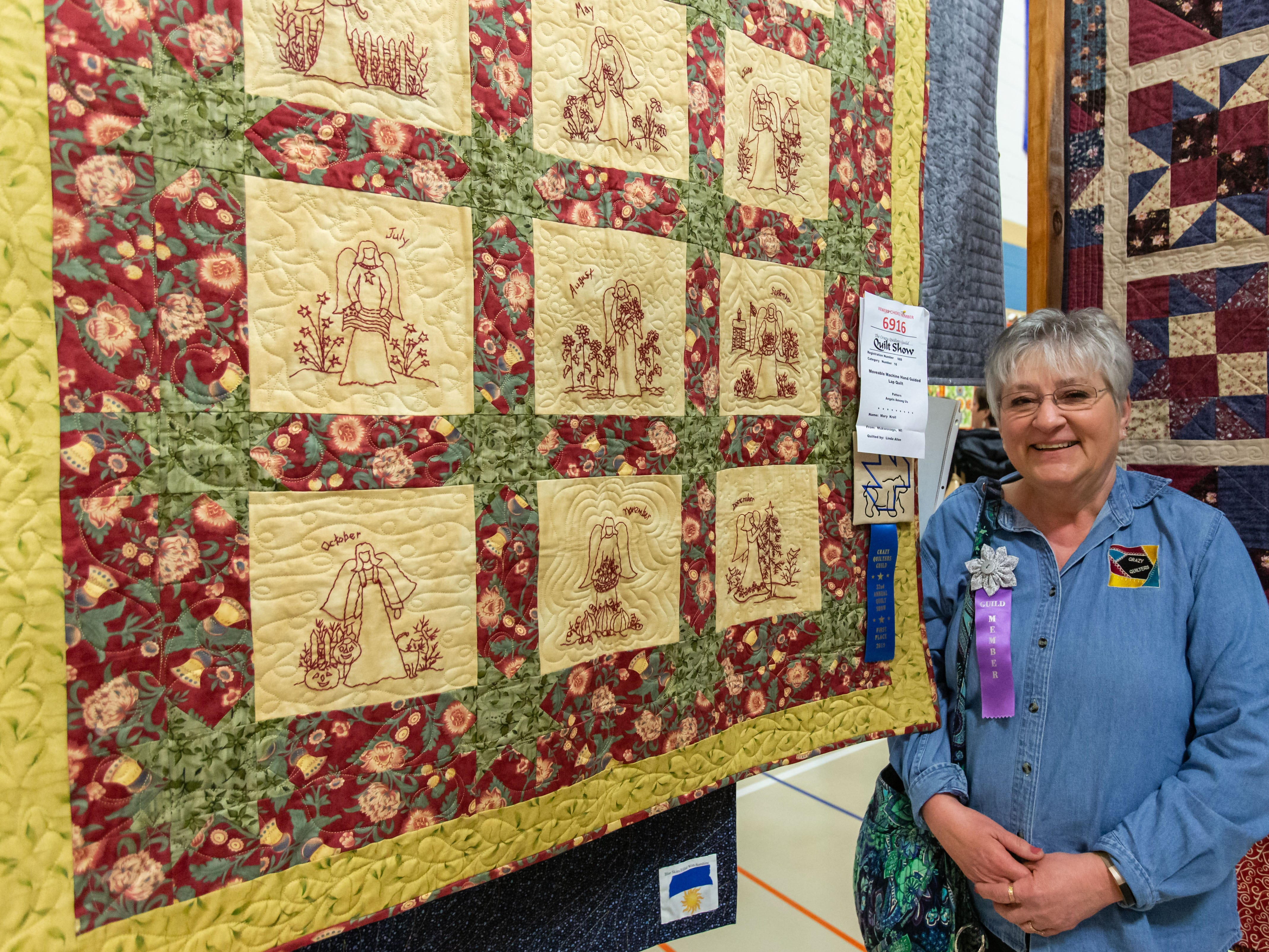 Mary Kroll of Mukwonago won 1st place for her Angels Among Us patterns on this quilt (at left) by Linda Allen during the Mukwonago Crazy Quilters 32nd annual Quilt Show at Park View Middle School on Saturday, March 30, 2019.