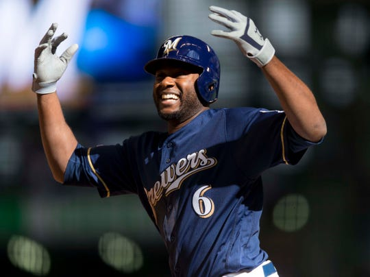 Mar 31, 2019; Milwaukee, WI, USA; Milwaukee Brewers center fielder Lorenzo Cain (6) celebrates after reaching base during the ninth inning against the St. Louis Cardinals at Miller Park. Mandatory Credit: Jeff Hanisch-USA TODAY Sports
