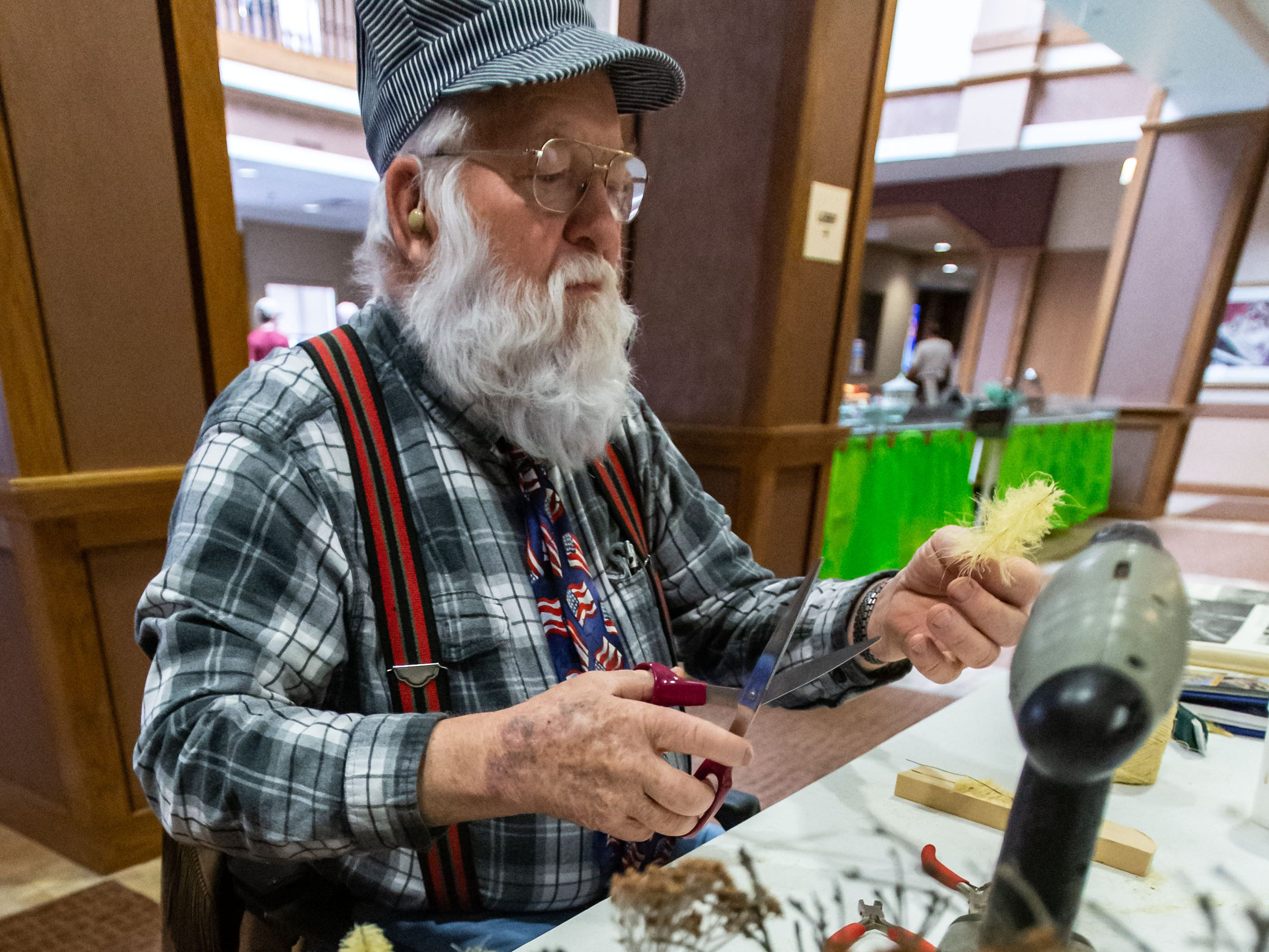 Richard Pyka of Ixonia uses twine and wire to create miniature trees during the Trains, Tracks and Switches exhibit at Shorehaven Health and Rehabilitation Center in Oconomowoc on Thursday, March 28, 2019. The annual three-day event, inspired by lead engineer and former Shorehaven resident Mert Leet, features model diesel and steam engine train sets and railroad memorabilia.