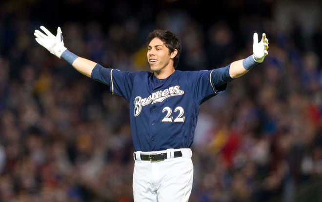 Brewers rightfielder Christian Yelich celebrates after hitting the game-winning double during the ninth inning Sunday.