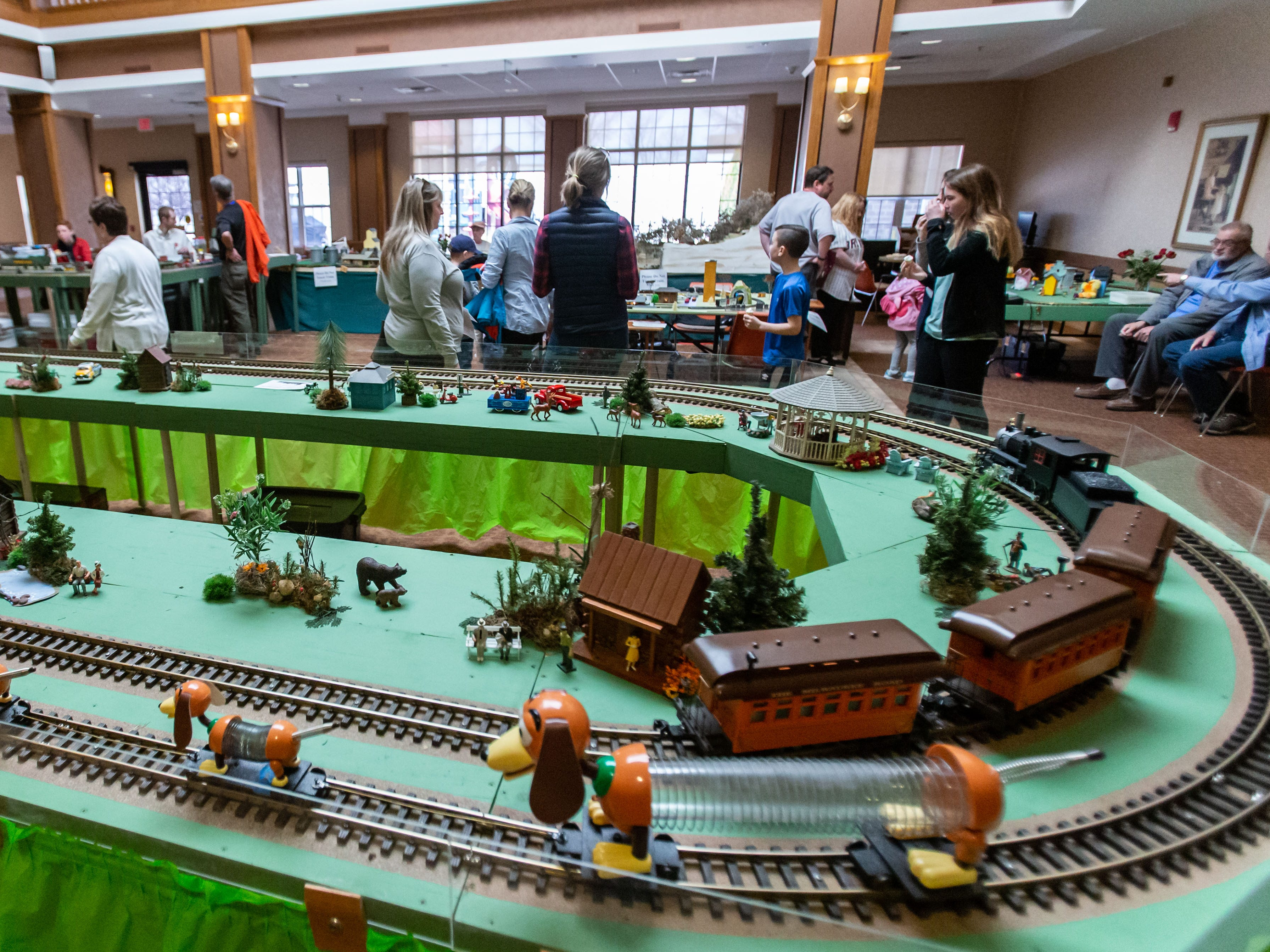 Residents and visitors enjoy the Trains, Tracks and Switches exhibit at Shorehaven Health and Rehabilitation Center in Oconomowoc on Thursday, March 28, 2019. The annual three-day event, inspired by lead engineer and former Shorehaven resident Mert Leet, features model diesel and steam engine train sets and railroad memorabilia.