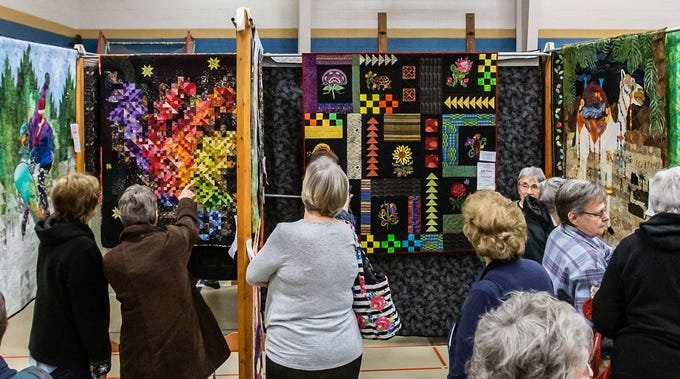 Attendees take in the beauty and craftsmanship on display during the Mukwonago Crazy Quilters 32nd annual Quilt Show at Park View Middle School on Saturday, March 30, 2019. The popular two-day event features show quilts, demonstrations, vendors, raffles, appraisals and more.