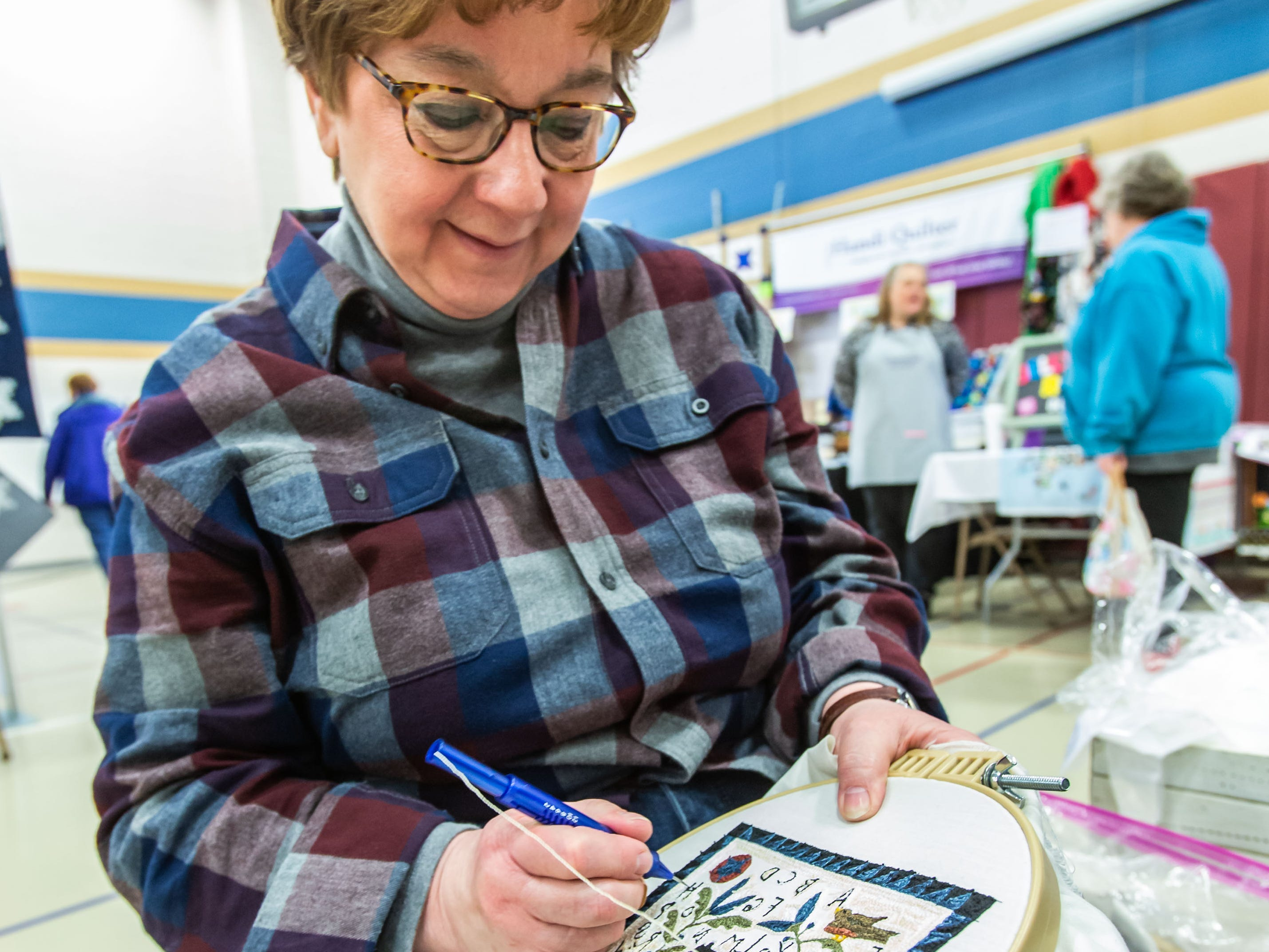 Deb Day of Stoughton works on her punch needle embroidery during the Mukwonago Crazy Quilters 32nd annual Quilt Show at Park View Middle School on Saturday, March 30, 2019.