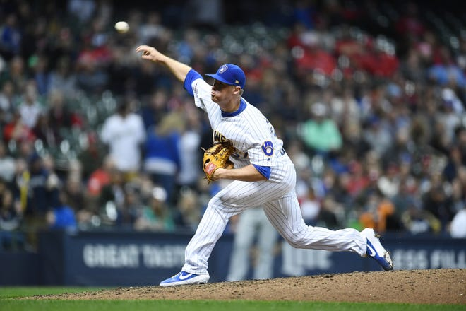 Chase Anderson began his adjustment  to relieving for Brewers with a two-inning stint against the Cardinals on Friday night.