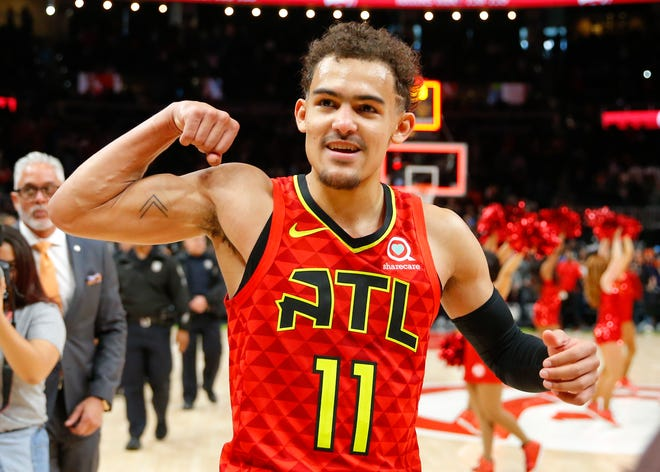 Trae Young reacts after the Hawks won in overtime against the Milwaukee Bucks on Sunday.