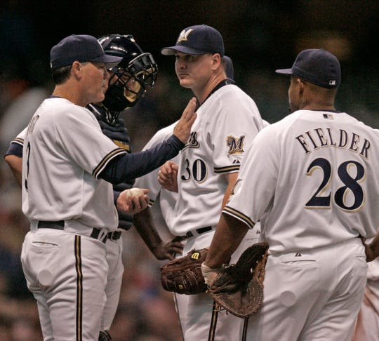 Brewers manager Ned Yost takes pitcher Rick Helling out of the game after he gave up a two-run homer to Detroit Tigers's Magglio Ordonez in the third inning. His game went downhill after a fast start.