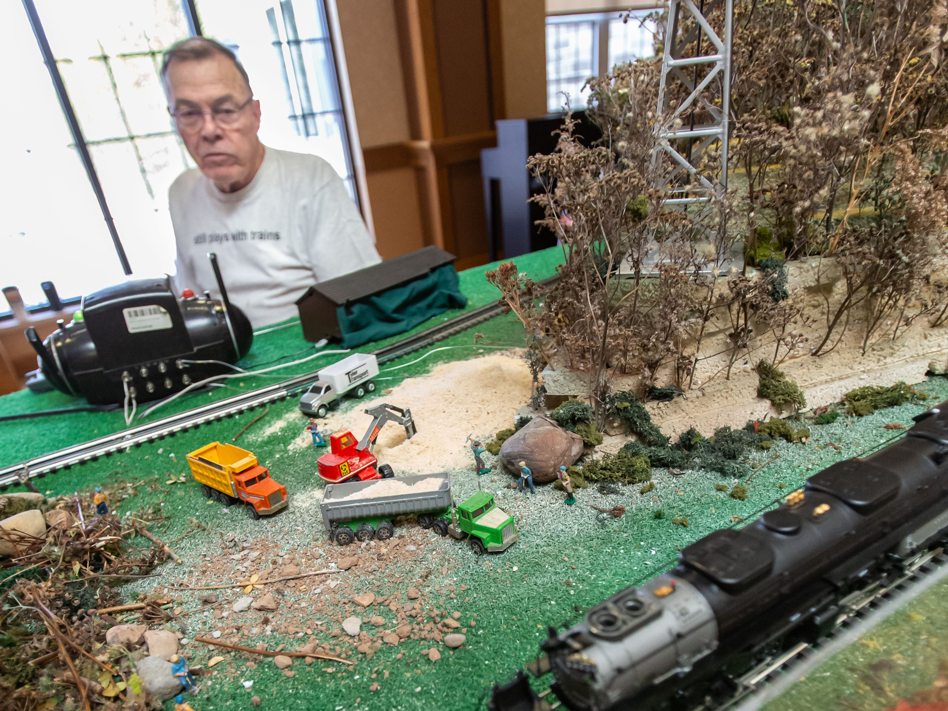 Dean Rupnow of Weyerhaeuser controls a train on his highly detailed layout during the Trains, Tracks and Switches exhibit at Shorehaven Health and Rehabilitation Center in Oconomowoc on Thursday, March 28, 2019.
