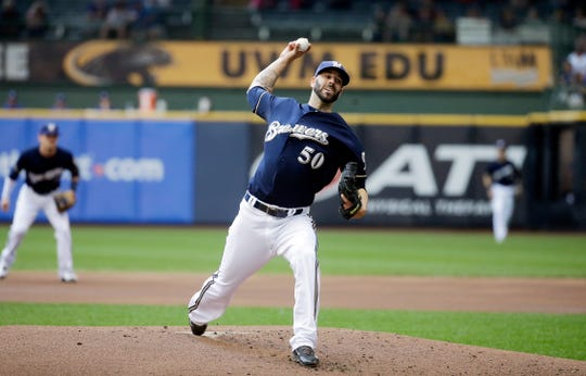 Mike Fiers pitches against the Los Angeles Dodgers in a game that turned quickly after his unblemished fourth inning.