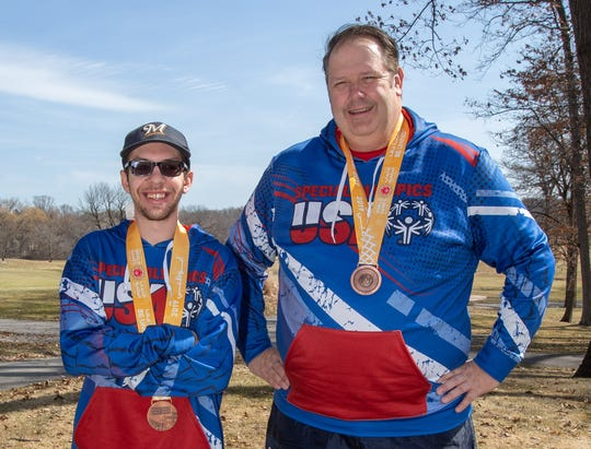 Ryon Knodl (left) of West Allis and his coach Ken Kuemmerlein display the Bronze Medals they won in golf at the 2019 Special Olympics World Games in Abu Dhabi, UAE. during an interview at New Berlin Hills Golf Course on Friday, March 29, 2019.