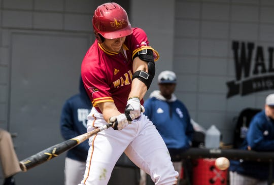 University of Louisiana at Monroe's Blake Buckman (22) swings at the ball resulting in a RBI during the game against Georgia Southern at Warhawk Field in Monroe, La. on March 31.