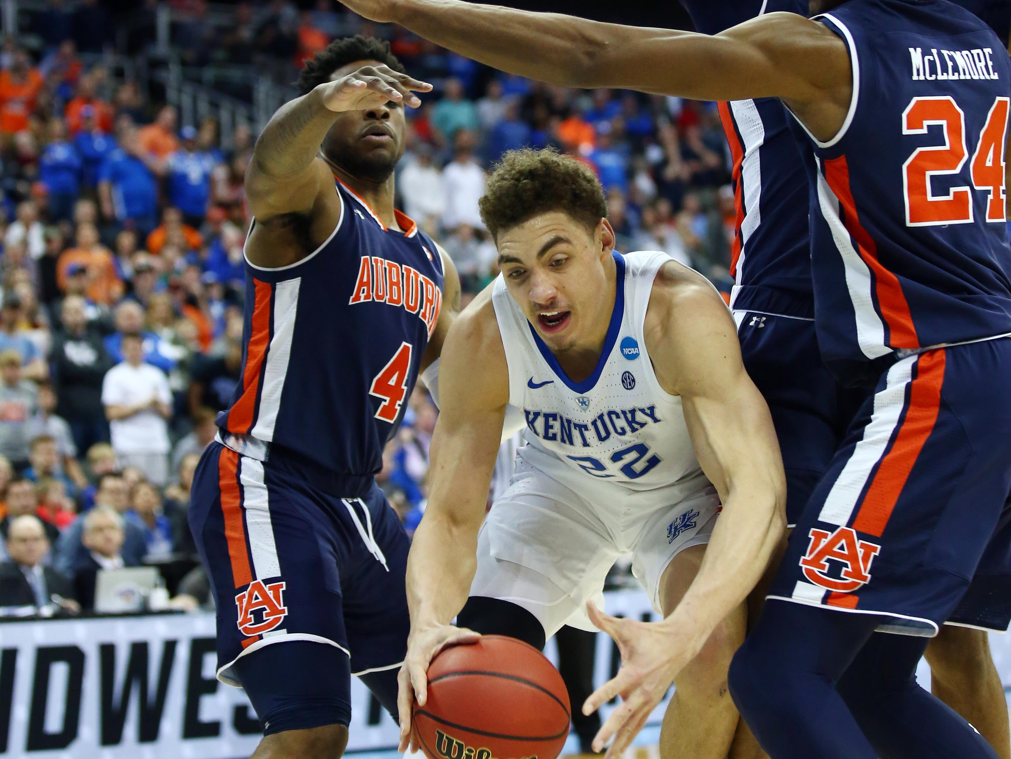 Mar 31, 2019; Kansas City, MO, United States; Kentucky Wildcats forward Reid Travis (22) tries to get between Auburn Tigers guard Malik Dunbar (4) and forward Anfernee McLemore (24) during the second half in the championship game of the midwest regional of the 2019 NCAA Tournament at Sprint Center. Mandatory Credit: Jay Biggerstaff-USA TODAY Sports
