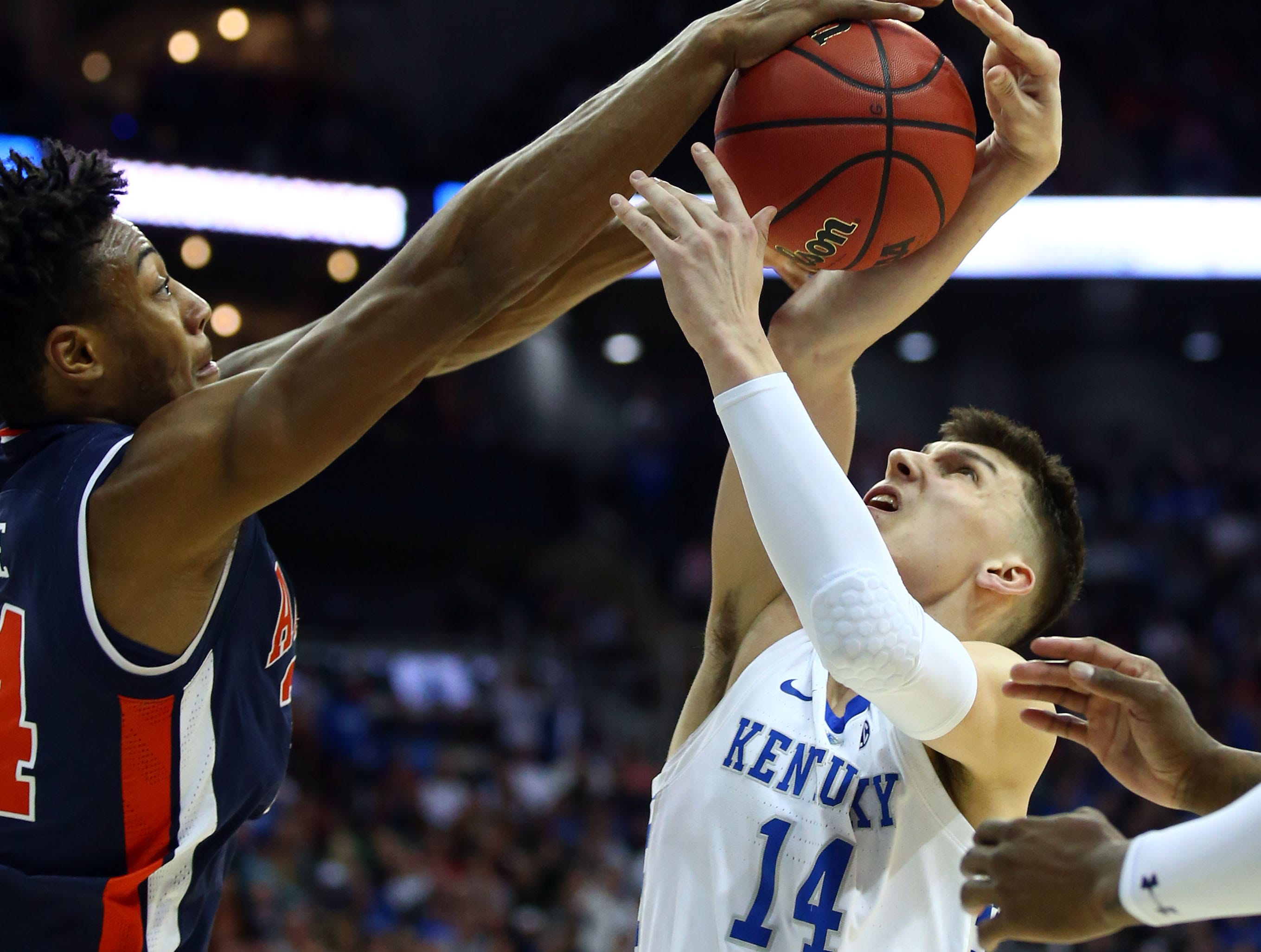 Mar 31, 2019; Kansas City, MO, United States; Auburn Tigers forward Anfernee McLemore (24) defends against Kentucky Wildcats guard Tyler Herro (14) during the second half in the championship game of the midwest regional of the 2019 NCAA Tournament at Sprint Center. Mandatory Credit: Jay Biggerstaff-USA TODAY Sports