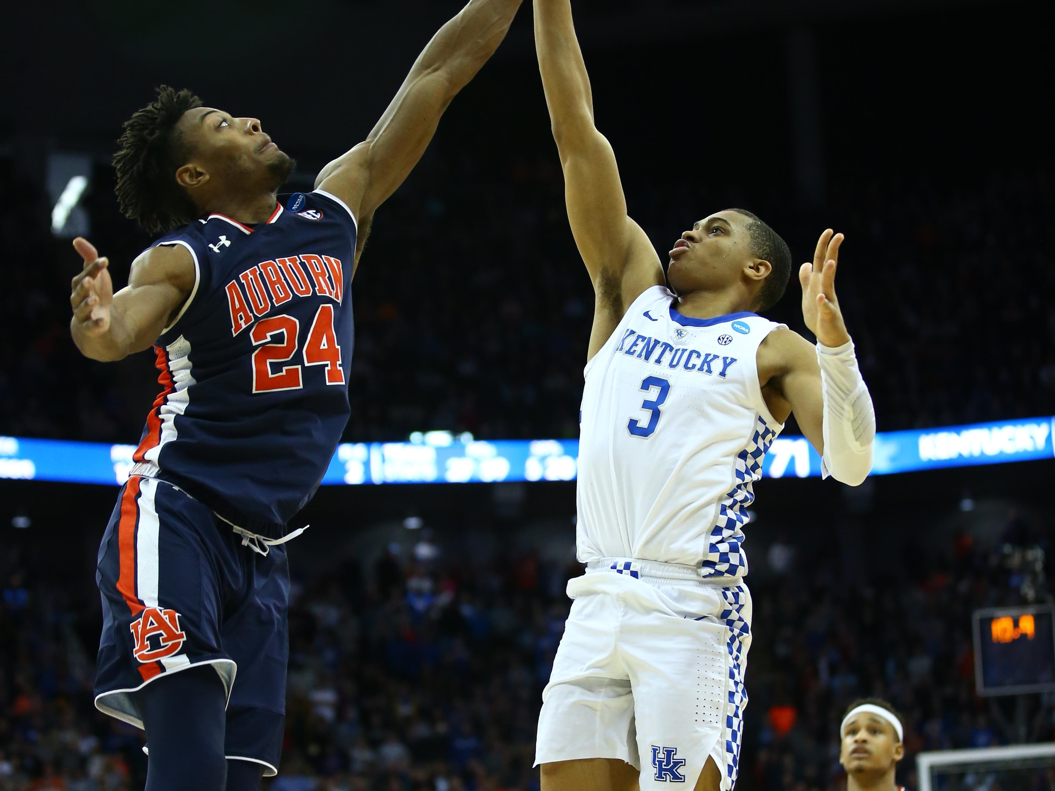Mar 31, 2019; Kansas City, MO, United States; Auburn Tigers forward Anfernee McLemore (24) blocks the shot of Kentucky Wildcats guard Keldon Johnson (3) during overtime in the championship game of the midwest regional of the 2019 NCAA Tournament at Sprint Center. Mandatory Credit: Jay Biggerstaff-USA TODAY Sports