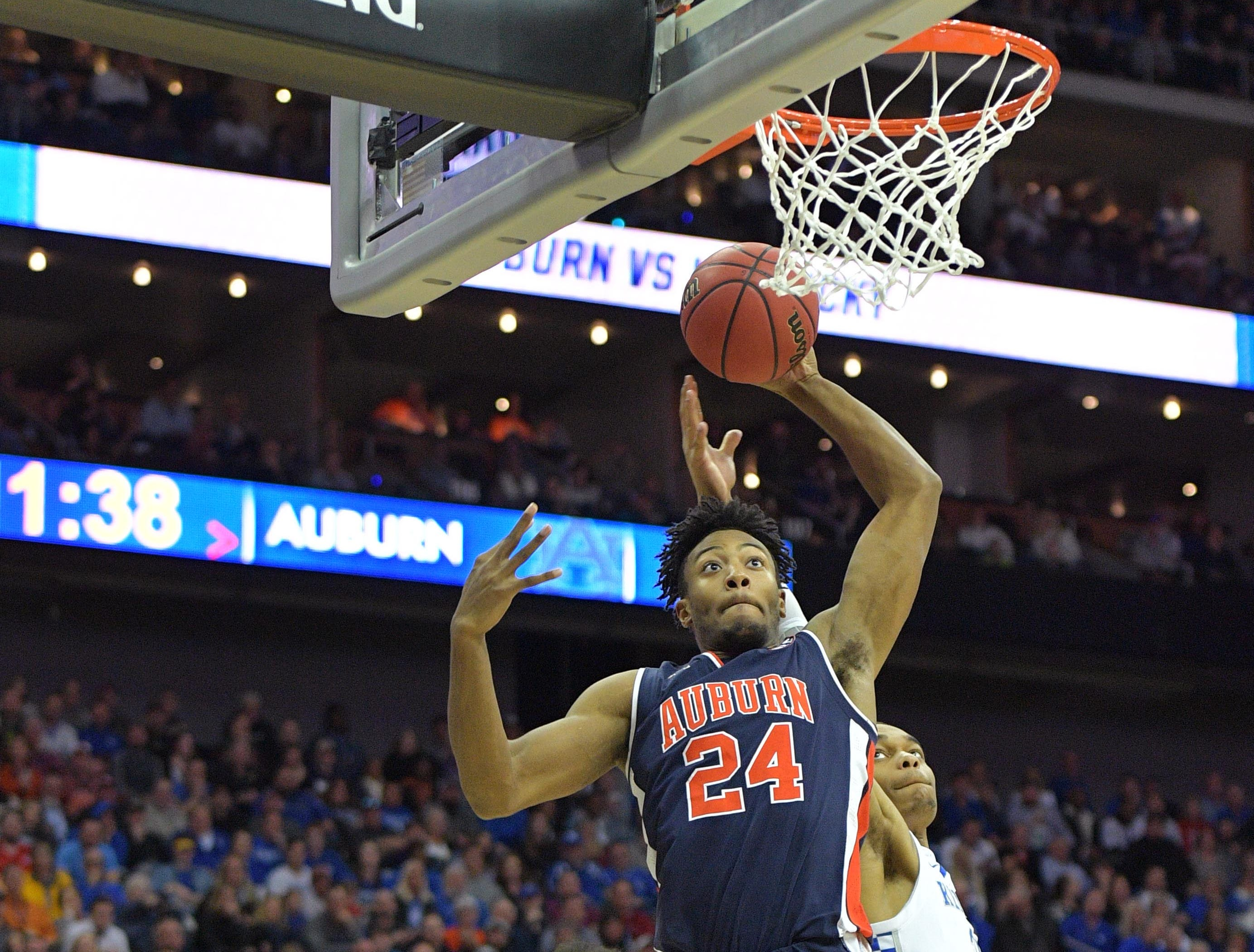 Mar 31, 2019; Kansas City, MO, United States; Auburn Tigers forward Anfernee McLemore (24) shoots as Kentucky Wildcats guard Ashton Hagans (2) watches during the second half in the championship game of the midwest regional of the 2019 NCAA Tournament at Sprint Center. Mandatory Credit: Denny Medley-USA TODAY Sports