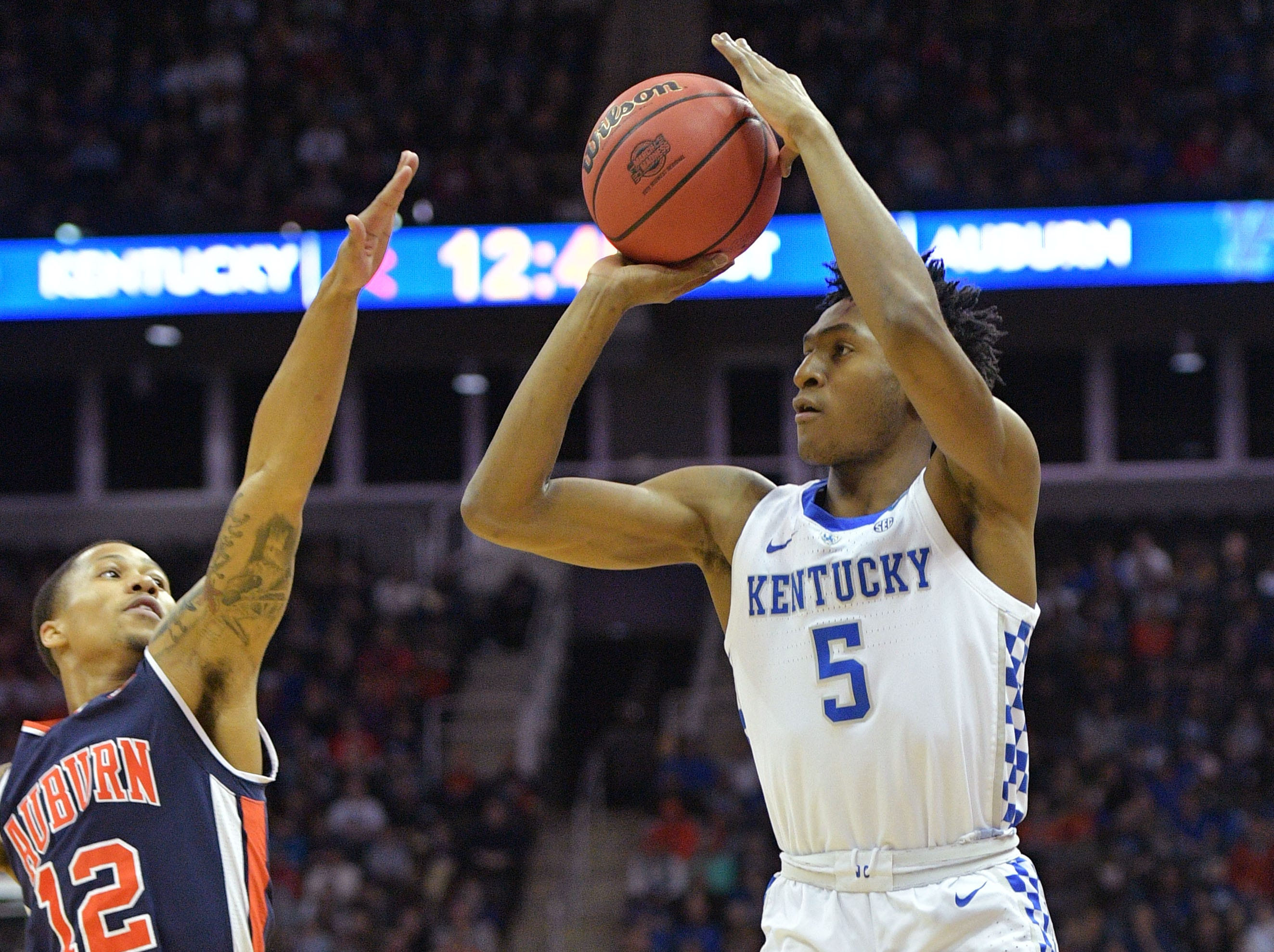 Mar 31, 2019; Kansas City, MO, United States; Kentucky Wildcats guard Immanuel Quickley (5) shoots over Auburn Tigers guard J'Von McCormick (12) during the first half in the championship game of the midwest regional of the 2019 NCAA Tournament at Sprint Center. Mandatory Credit: Denny Medley-USA TODAY Sports