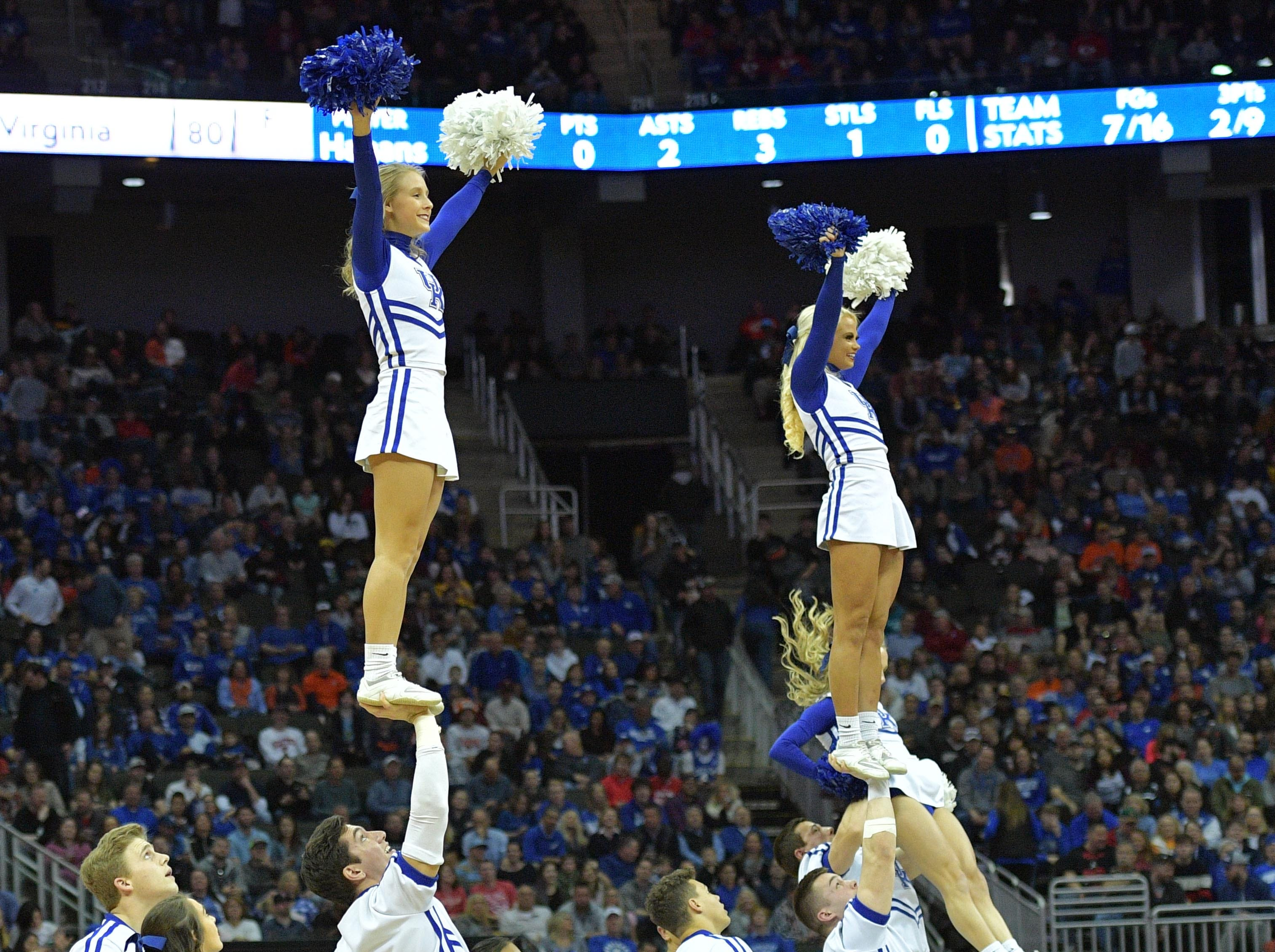 Mar 31, 2019; Kansas City, MO, United States; Kentucky Wildcats cheerleaders perform against the Auburn Tigers during the first half in the championship game of the midwest regional of the 2019 NCAA Tournament at Sprint Center. Mandatory Credit: Denny Medley-USA TODAY Sports