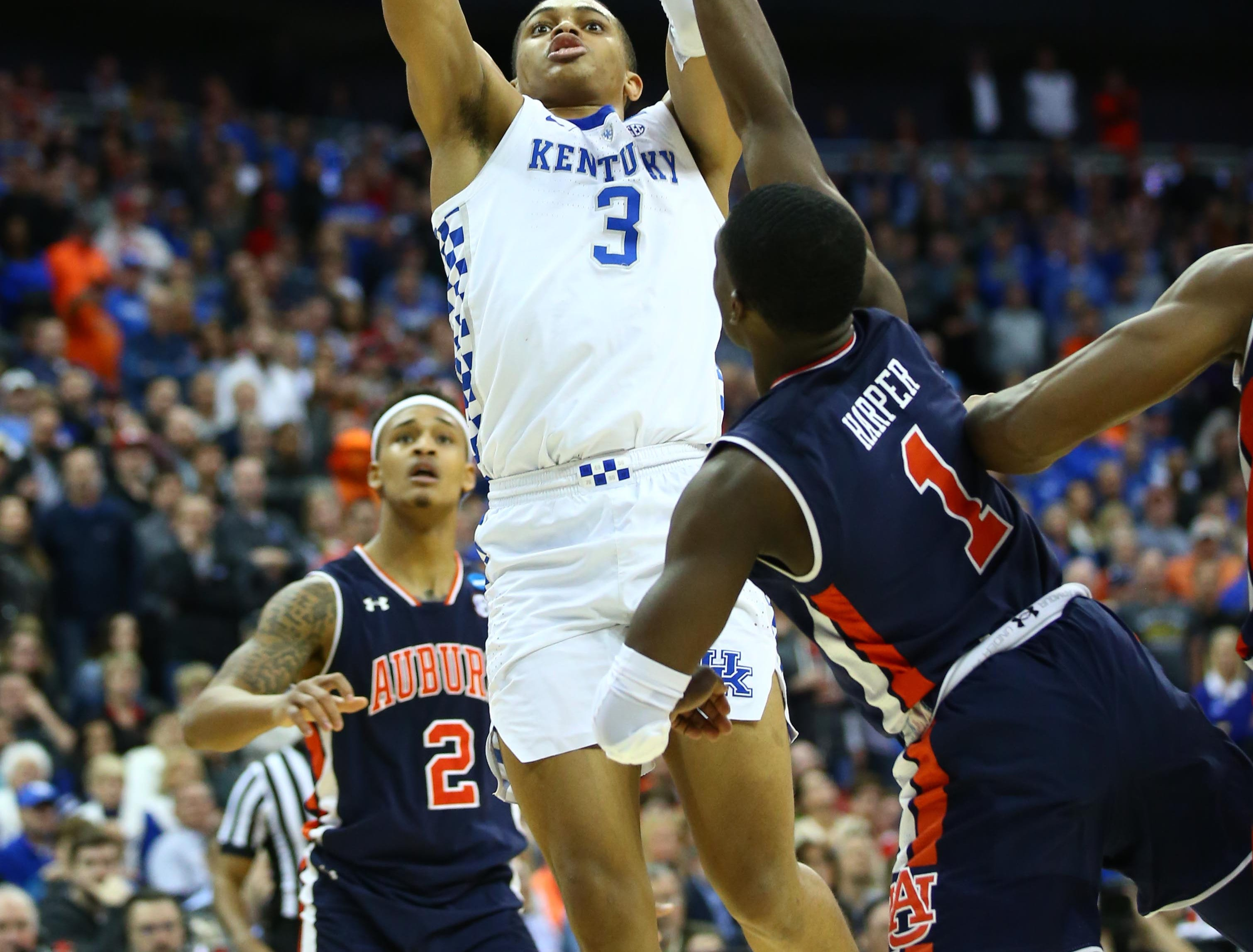 Mar 31, 2019; Kansas City, MO, United States; Kentucky Wildcats guard Keldon Johnson (3) shoots over Auburn Tigers guard Jared Harper (1) during the second half in the championship game of the midwest regional of the 2019 NCAA Tournament at Sprint Center. Mandatory Credit: Jay Biggerstaff-USA TODAY Sports