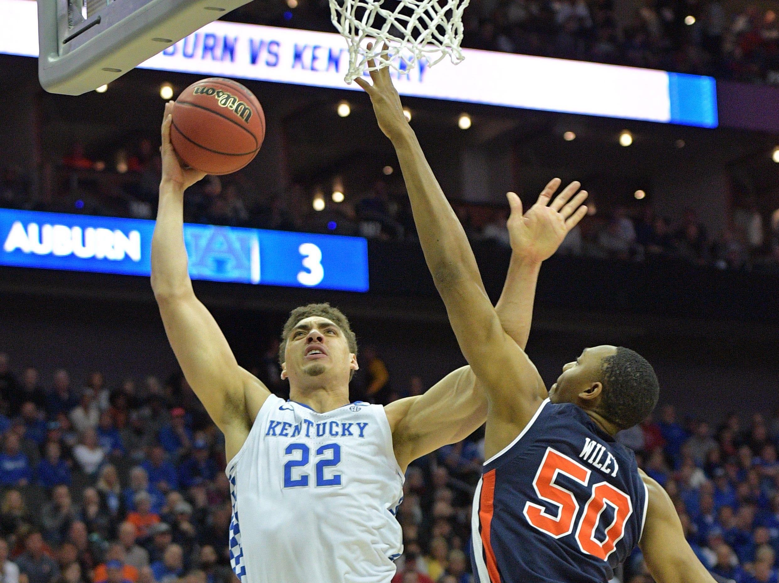Mar 31, 2019; Kansas City, MO, United States; Kentucky Wildcats forward Reid Travis (22) shoots against Auburn Tigers center Austin Wiley (50) during the first half in the championship game of the midwest regional of the 2019 NCAA Tournament at Sprint Center. Mandatory Credit: Denny Medley-USA TODAY Sports