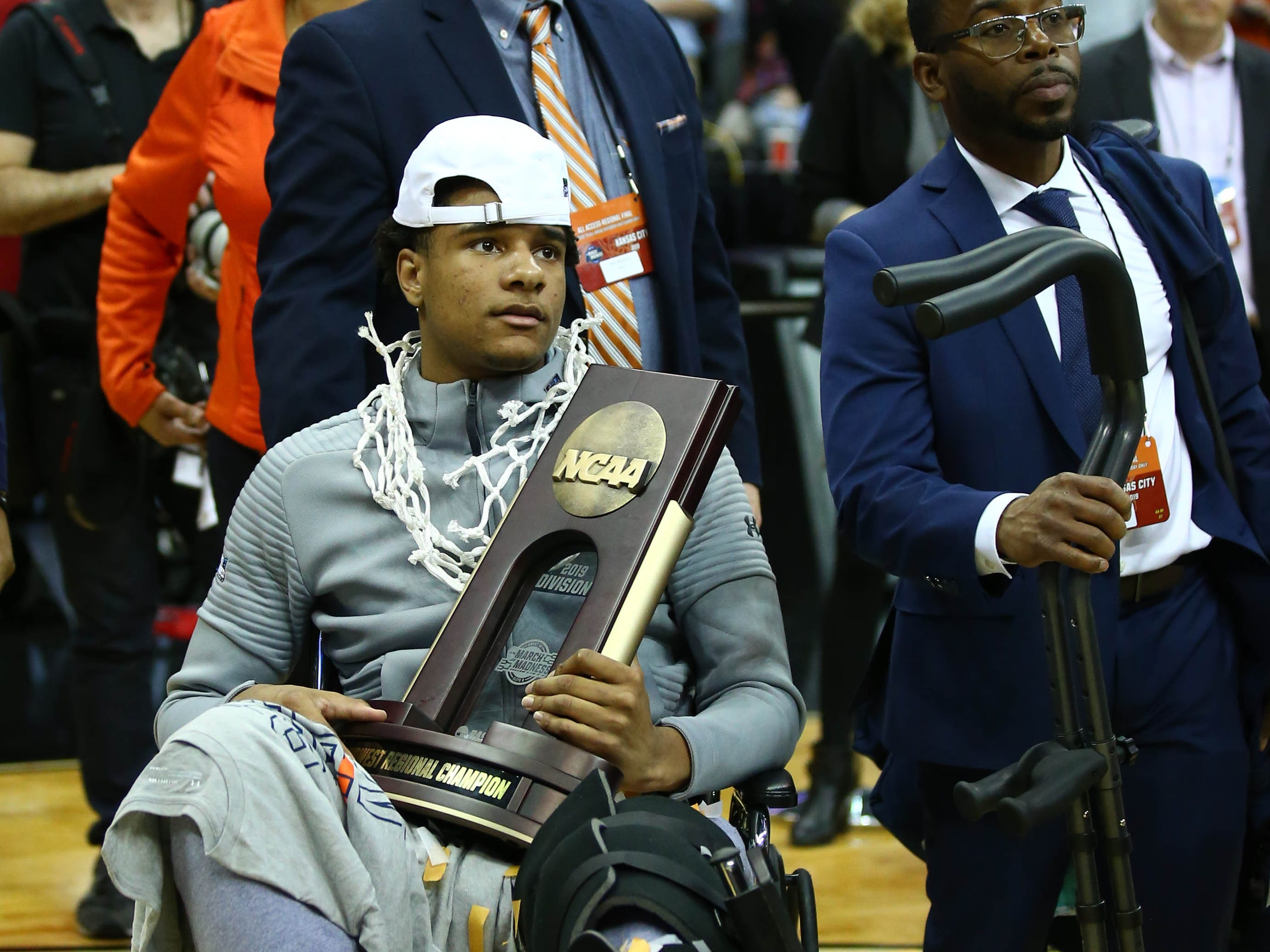 Mar 31, 2019; Kansas City, MO, United States; Auburn Tigers forward Chuma Okeke with the trophy after defeating the Kentucky Wildcats in the championship game of the midwest regional of the 2019 NCAA Tournament at Sprint Center. Mandatory Credit: Jay Biggerstaff-USA TODAY Sports
