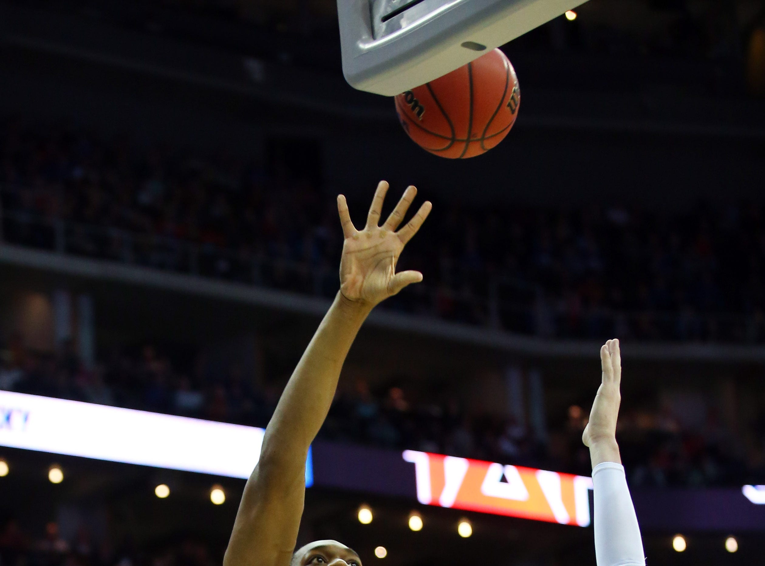 Mar 31, 2019; Kansas City, MO, United States; Auburn Tigers center Austin Wiley (50) shoots over Kentucky Wildcats guard Tyler Herro (14) during the first half in the championship game of the midwest regional of the 2019 NCAA Tournament at Sprint Center. Mandatory Credit: Jay Biggerstaff-USA TODAY Sports