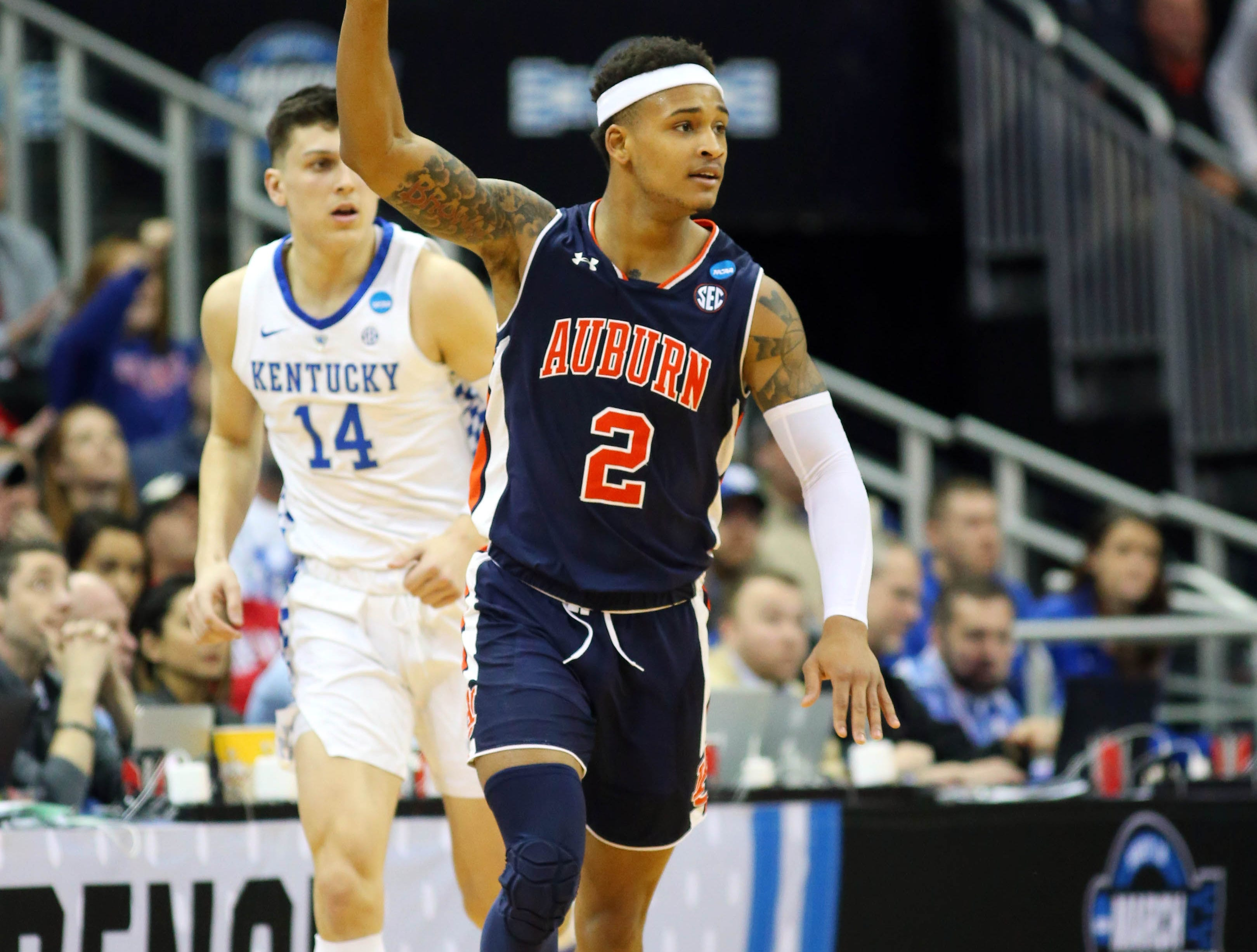 Mar 31, 2019; Kansas City, MO, United States; Auburn Tigers guard Bryce Brown (2) celebrates a three point basket against the Kentucky Wildcats during the second half in the championship game of the midwest regional of the 2019 NCAA Tournament at Sprint Center. Mandatory Credit: Jay Biggerstaff-USA TODAY Sports
