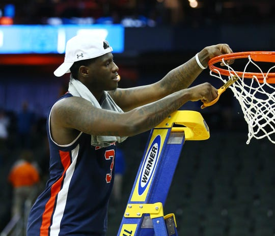 Mar 31, 2019; Kansas City, MO, United States; Auburn Tigers forward Danjel Purifoy (3) cuts down the net after defeating the Kentucky Wildcats in the championship game of the midwest regional of the 2019 NCAA Tournament at Sprint Center. Mandatory Credit: Jay Biggerstaff-USA TODAY Sports