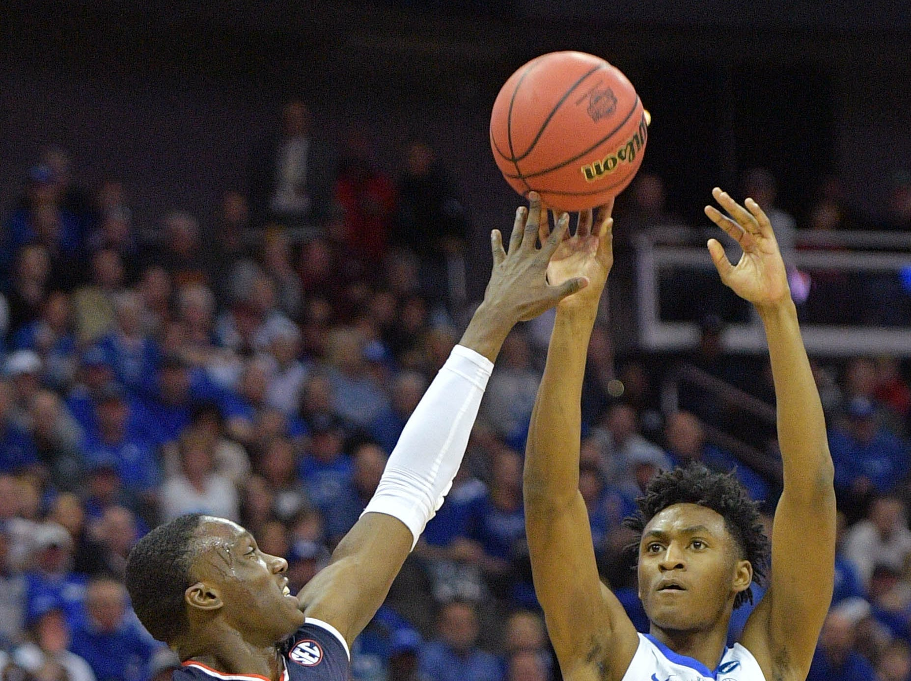 Mar 31, 2019; Kansas City, MO, United States; Kentucky Wildcats guard Immanuel Quickley (5) shoots over Auburn Tigers guard Jared Harper (1) during the first half in the championship game of the midwest regional of the 2019 NCAA Tournament at Sprint Center. Mandatory Credit: Denny Medley-USA TODAY Sports