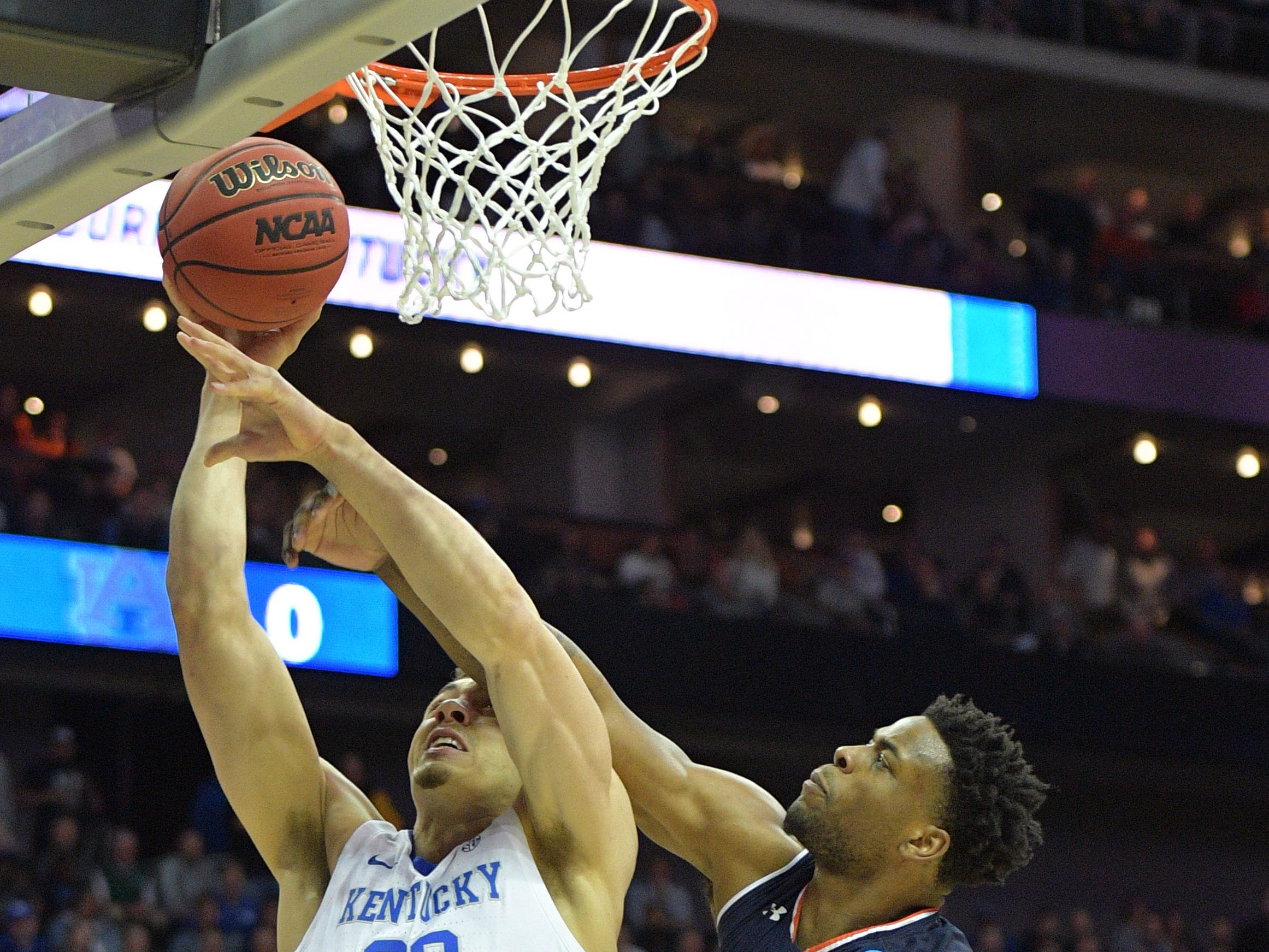 Mar 31, 2019; Kansas City, MO, United States; Kentucky Wildcats forward Reid Travis (22) shoots against Auburn Tigers guard Malik Dunbar (4) during the first half in the championship game of the midwest regional of the 2019 NCAA Tournament at Sprint Center. Mandatory Credit: Denny Medley-USA TODAY Sports