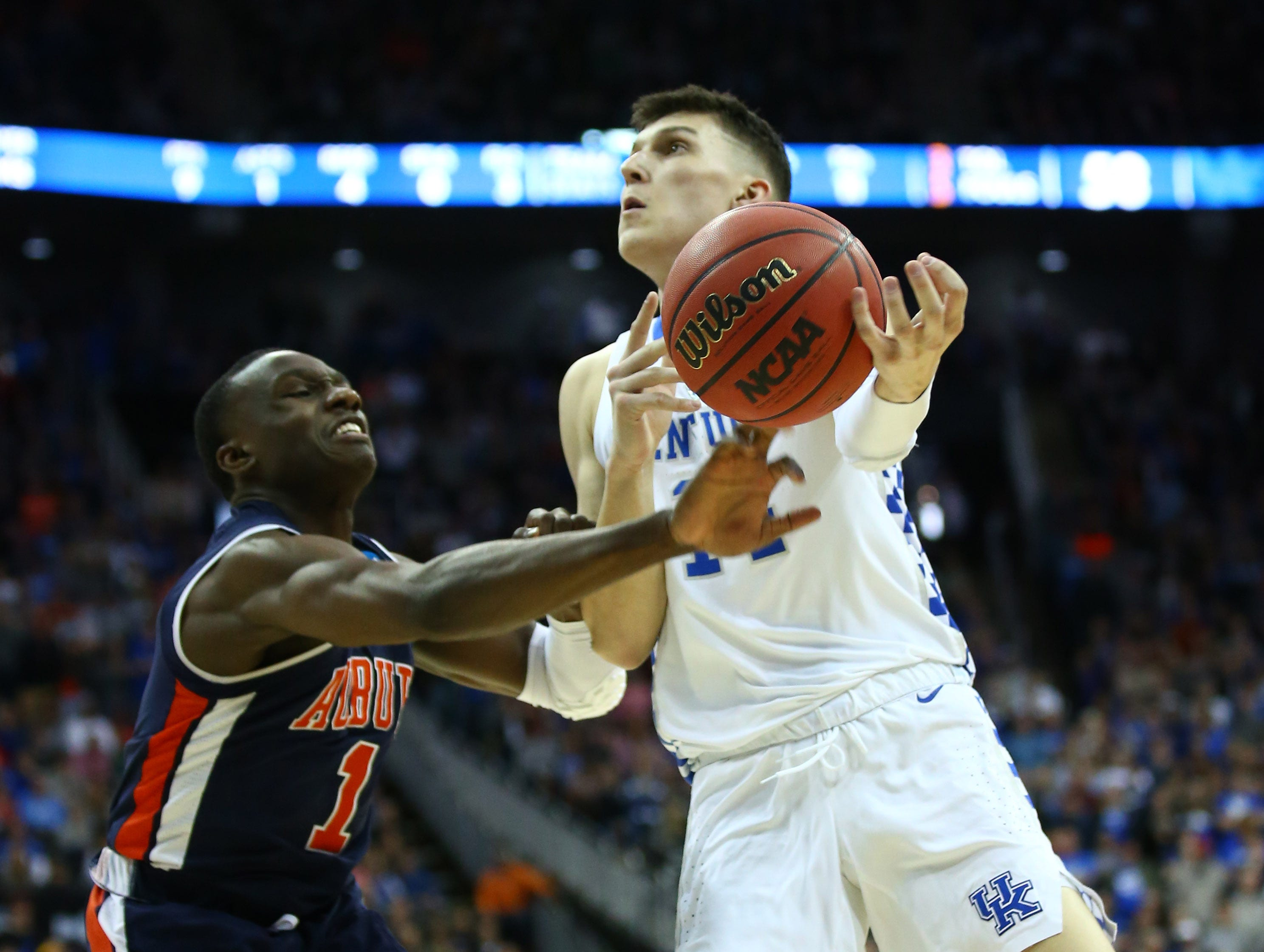 Mar 31, 2019; Kansas City, MO, United States; Auburn Tigers guard Jared Harper (1) knocks the ball away from Kentucky Wildcats guard Tyler Herro (14) during the second half in the championship game of the midwest regional of the 2019 NCAA Tournament at Sprint Center. Mandatory Credit: Jay Biggerstaff-USA TODAY Sports