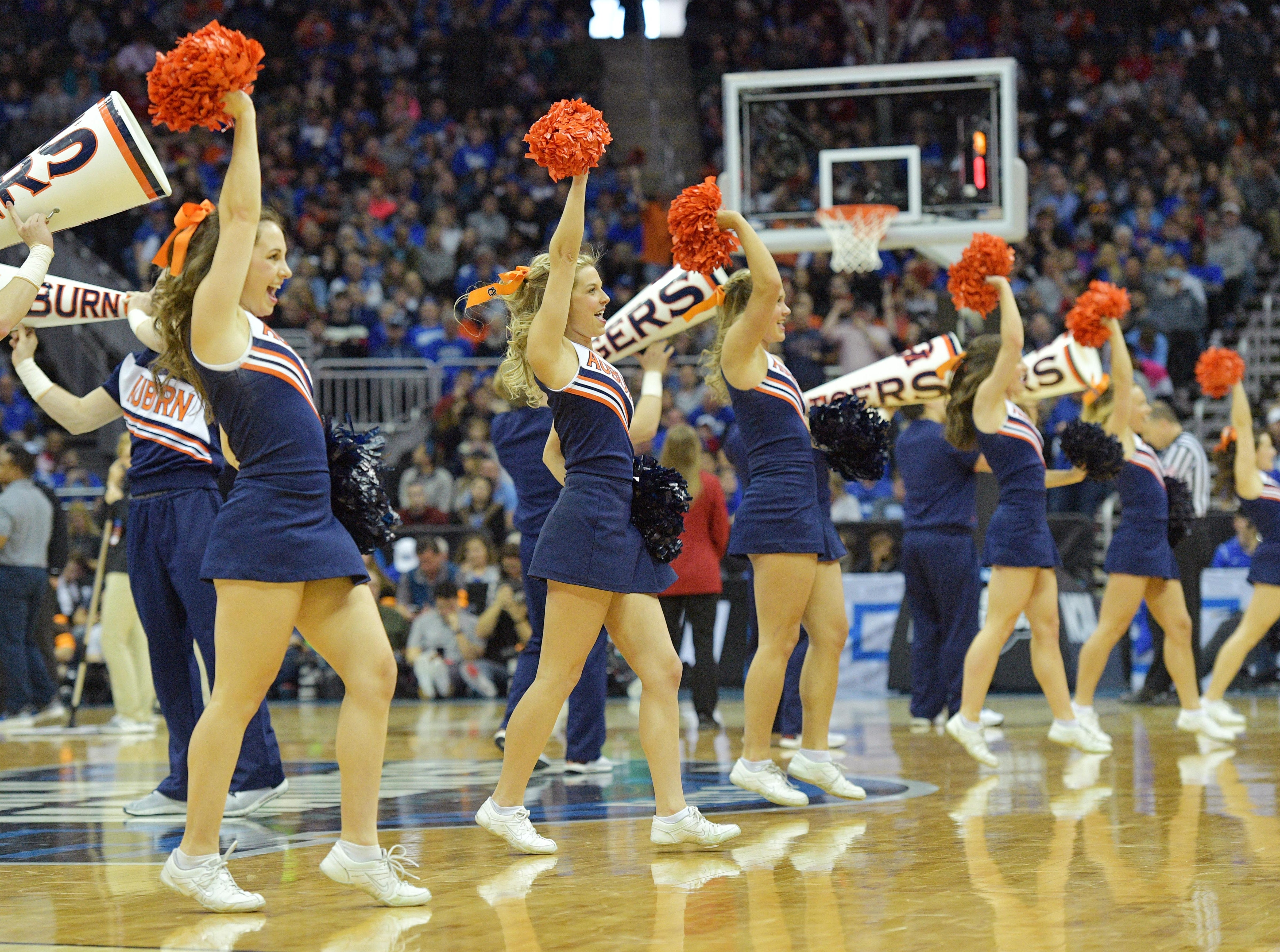 Mar 31, 2019; Kansas City, MO, United States; Auburn Tigers cheerleaders perform against the Kentucky Wildcats during the second half in the championship game of the midwest regional of the 2019 NCAA Tournament at Sprint Center. Mandatory Credit: Denny Medley-USA TODAY Sports