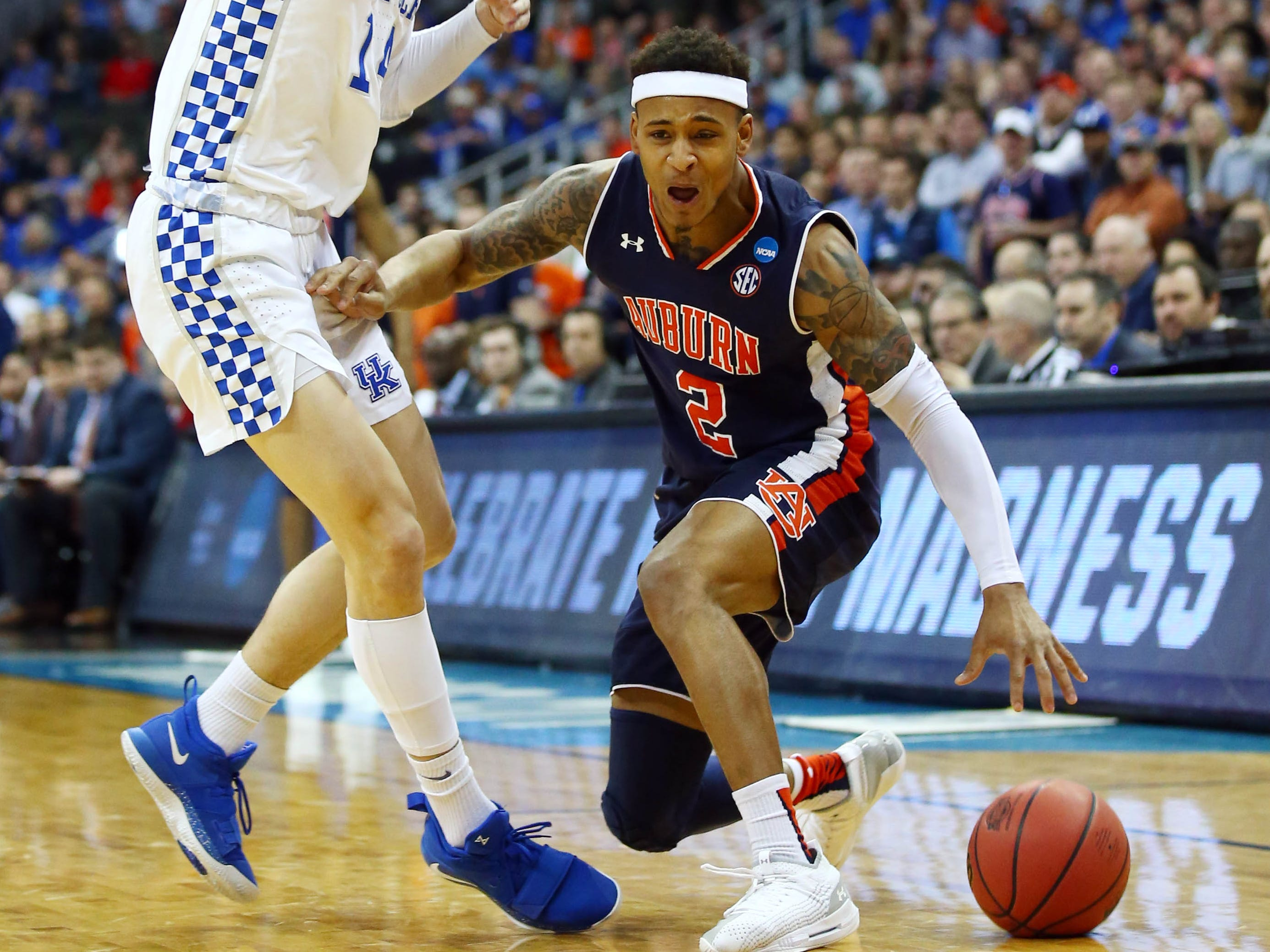 Mar 31, 2019; Kansas City, MO, United States; Auburn Tigers guard Bryce Brown (2) dribbles the ball against Kentucky Wildcats guard Tyler Herro (14) during the first half in the championship game of the midwest regional of the 2019 NCAA Tournament at Sprint Center. Mandatory Credit: Jay Biggerstaff-USA TODAY Sports