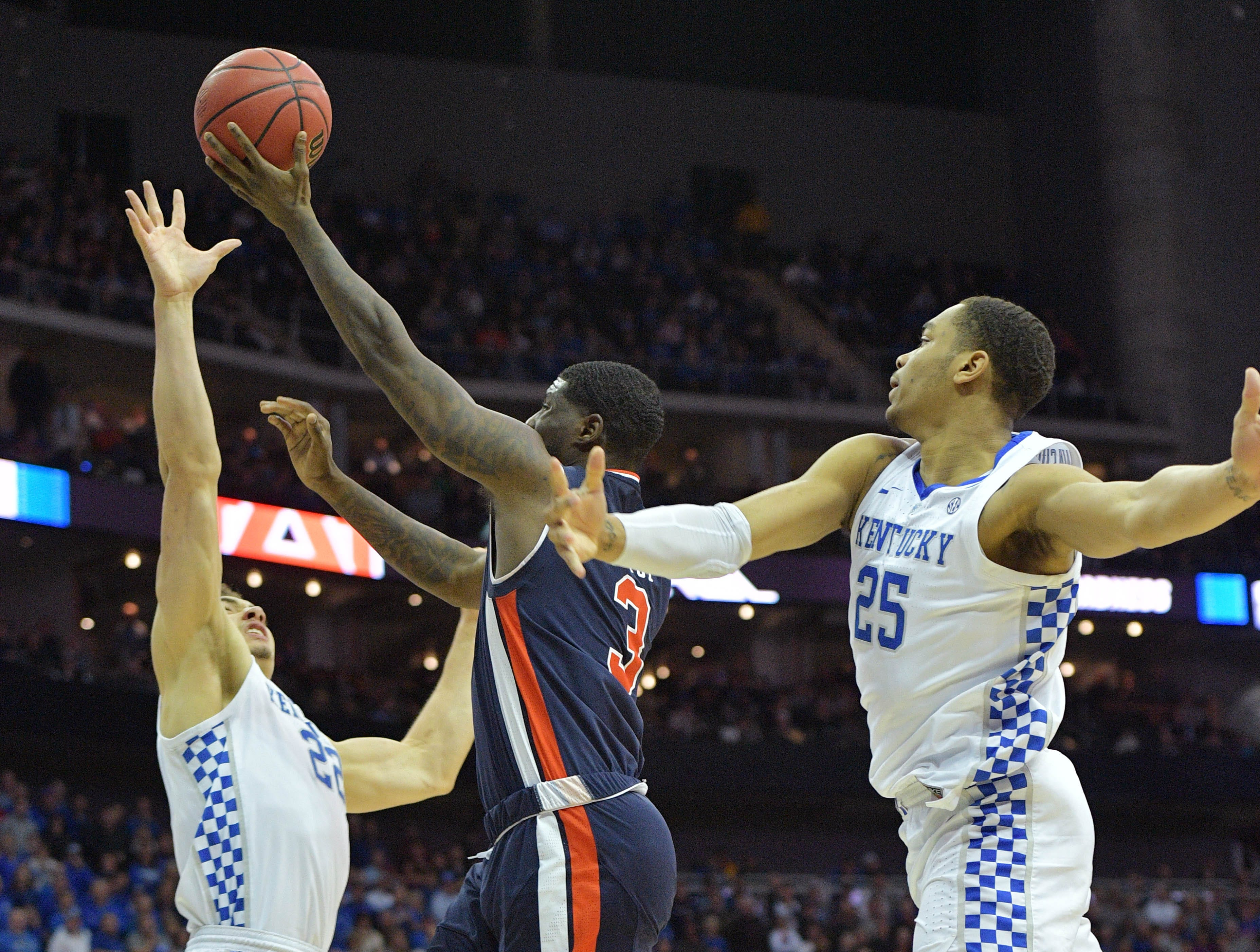 Mar 31, 2019; Kansas City, MO, United States; Auburn Tigers forward Danjel Purifoy (3) shoots against Kentucky Wildcats forward PJ Washington (25) and forward Reid Travis (22) during the second half in the championship game of the midwest regional of the 2019 NCAA Tournament at Sprint Center. Mandatory Credit: Denny Medley-USA TODAY Sports