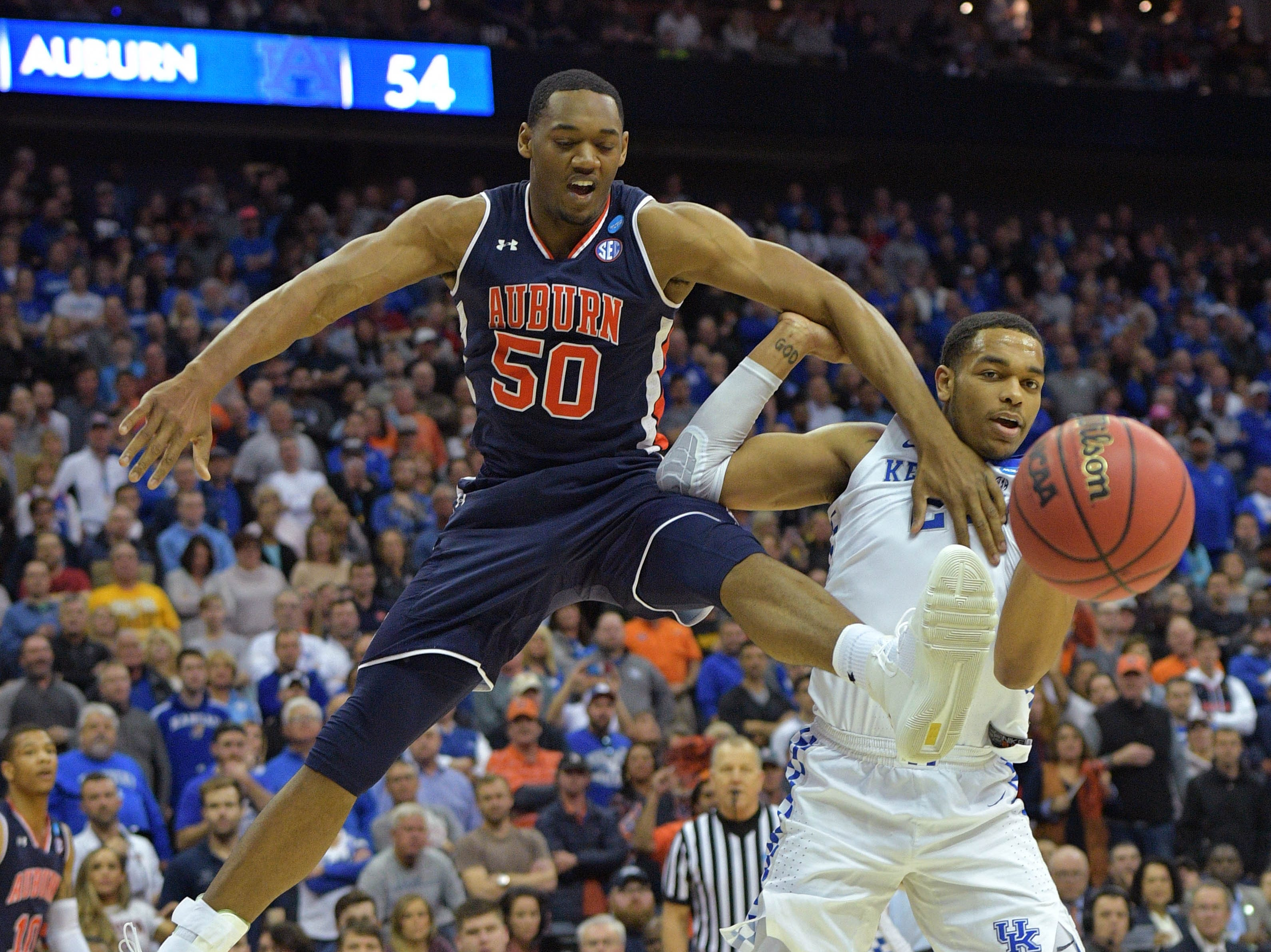 Mar 31, 2019; Kansas City, MO, United States; Auburn Tigers center Austin Wiley (50) chases a rebound with Kentucky Wildcats forward PJ Washington (25) during the second half in the championship game of the midwest regional of the 2019 NCAA Tournament at Sprint Center. Mandatory Credit: Denny Medley-USA TODAY Sports