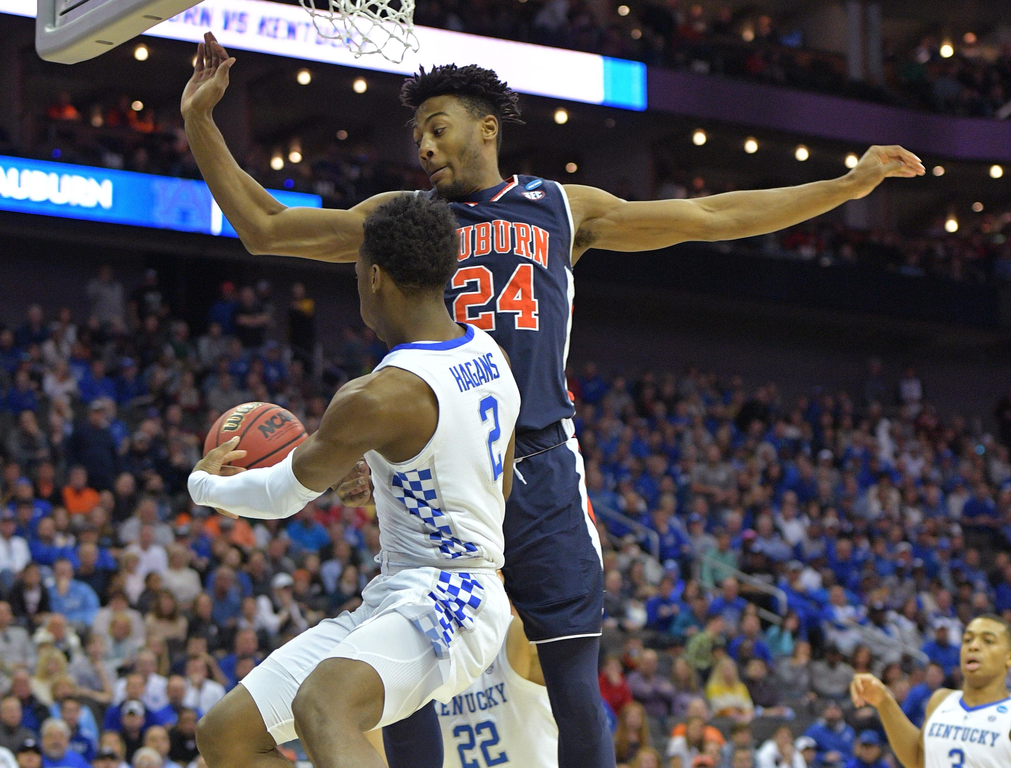 Mar 31, 2019; Kansas City, MO, United States; Kentucky Wildcats guard Ashton Hagans (2) passes the ball away from Auburn Tigers forward Anfernee McLemore (24) during the first half in the championship game of the midwest regional of the 2019 NCAA Tournament at Sprint Center. Mandatory Credit: Denny Medley-USA TODAY Sports