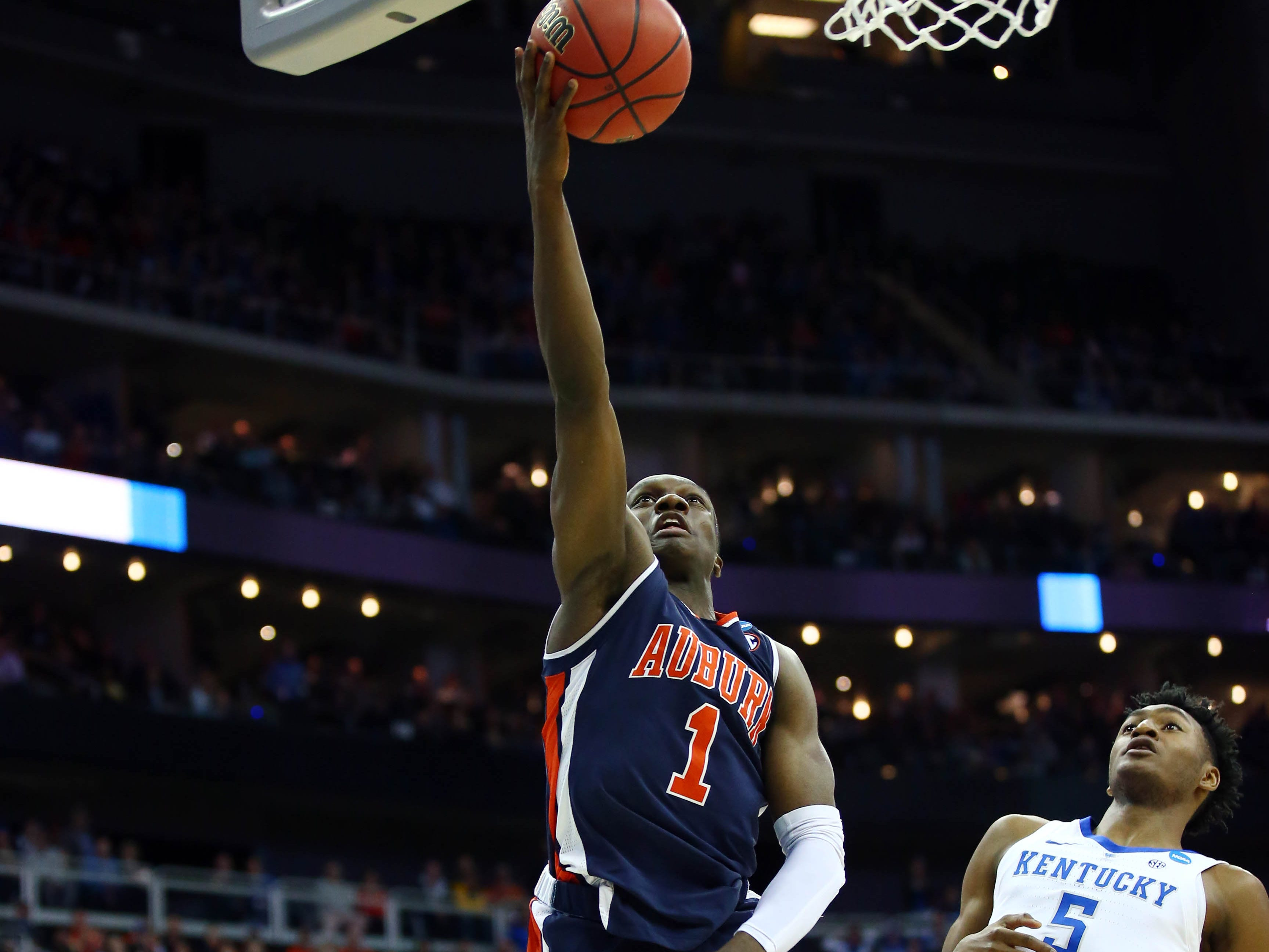 Mar 31, 2019; Kansas City, MO, United States; Auburn Tigers guard Jared Harper (1) shoots against Kentucky Wildcats guard Immanuel Quickley (5) during the first half in the championship game of the midwest regional of the 2019 NCAA Tournament at Sprint Center. Mandatory Credit: Jay Biggerstaff-USA TODAY Sports