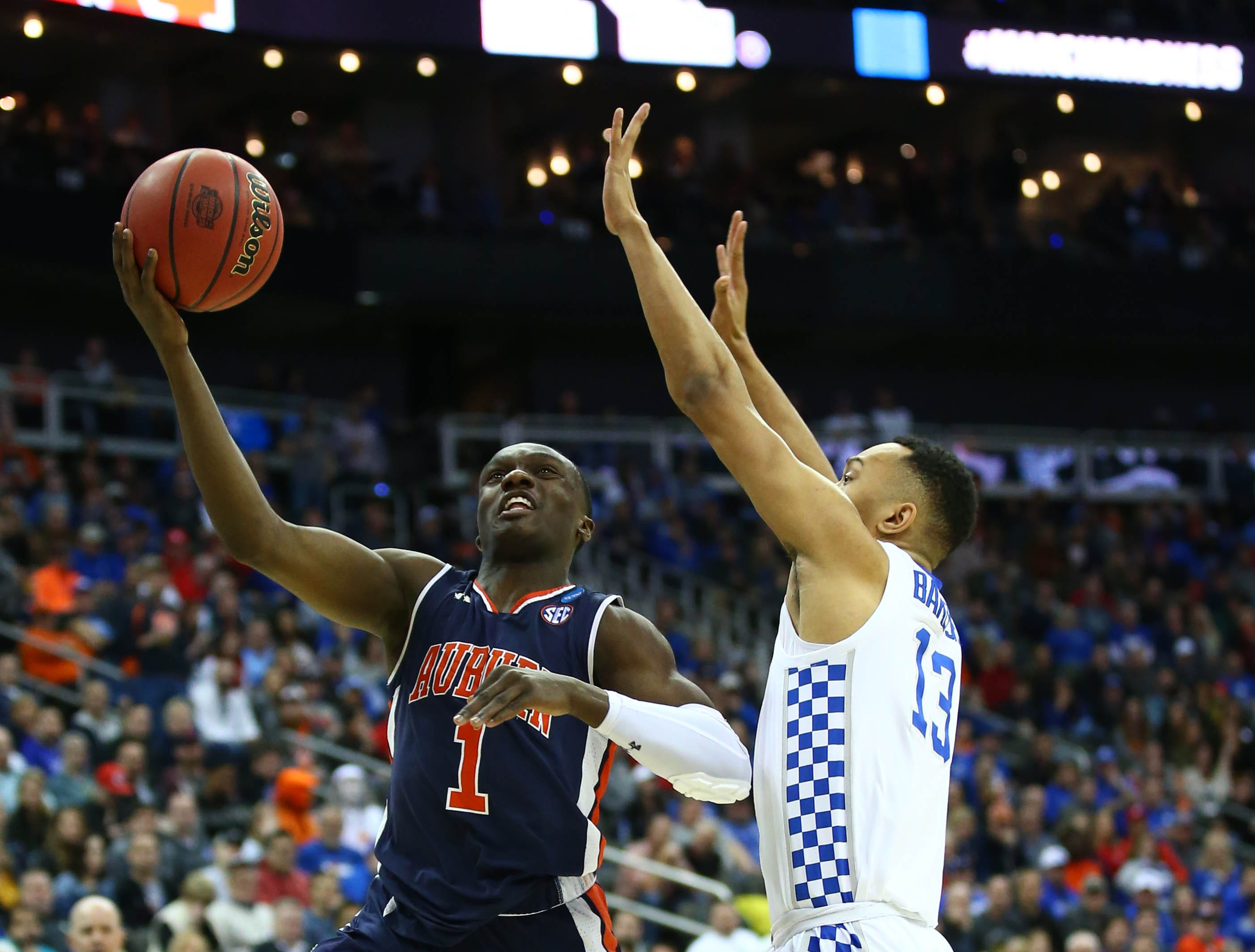 Mar 31, 2019; Kansas City, MO, United States; Auburn Tigers guard Jared Harper (1) shoots against Kentucky Wildcats guard Jemarl Baker Jr. (13) during the first half in the championship game of the midwest regional of the 2019 NCAA Tournament at Sprint Center. Mandatory Credit: Jay Biggerstaff-USA TODAY Sports
