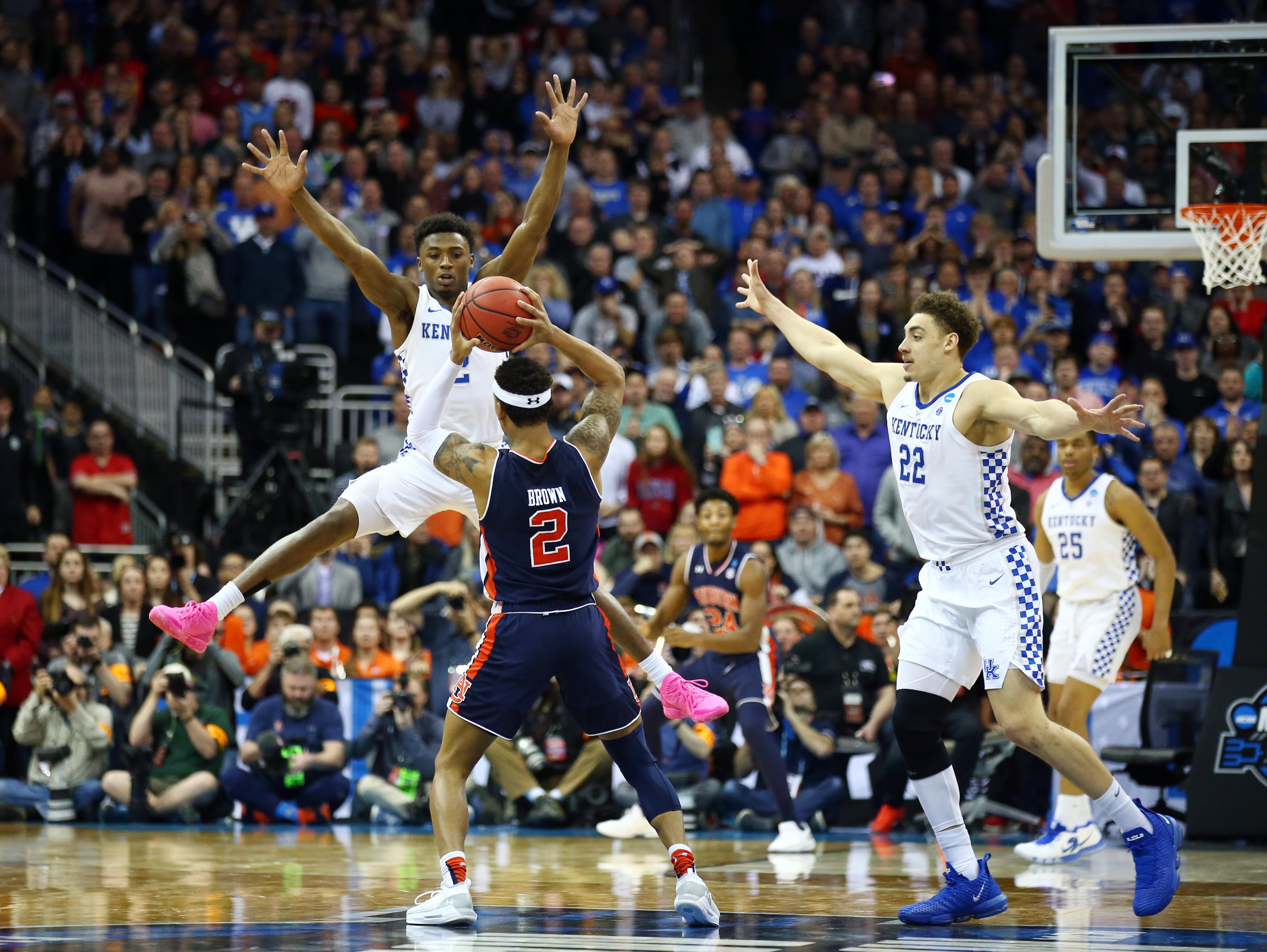Mar 31, 2019; Kansas City, MO, United States; Auburn Tigers guard Bryce Brown (2) is defended by Kentucky Wildcats guard Ashton Hagans (2) and forward Reid Travis (22) during the second half in the championship game of the midwest regional of the 2019 NCAA Tournament at Sprint Center. Mandatory Credit: Jay Biggerstaff-USA TODAY Sports