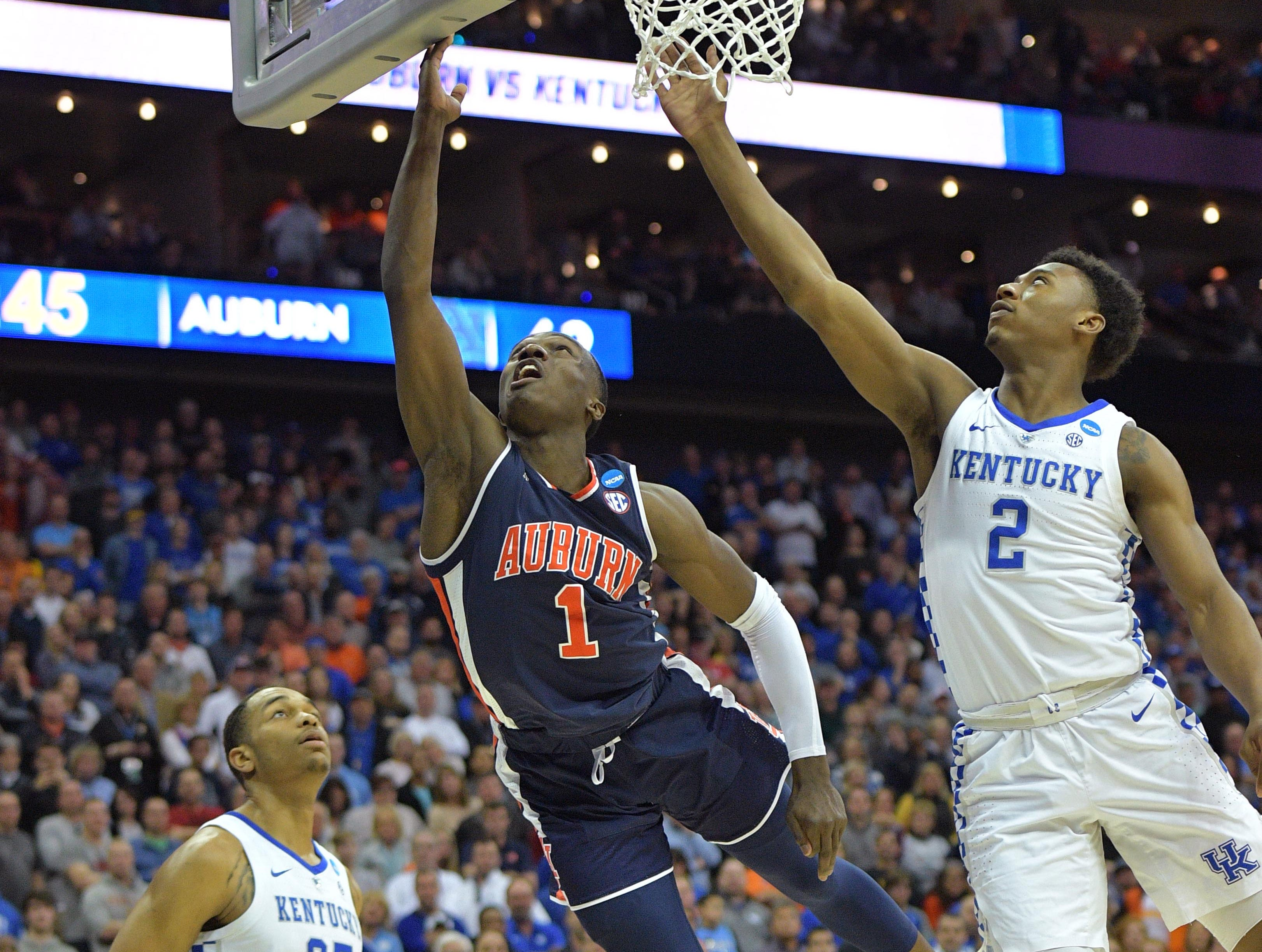 Mar 31, 2019; Kansas City, MO, United States; Auburn Tigers guard Jared Harper (1) shoots against Kentucky Wildcats guard Ashton Hagans (2) during overtime in the championship game of the midwest regional of the 2019 NCAA Tournament at Sprint Center. Mandatory Credit: Denny Medley-USA TODAY Sports