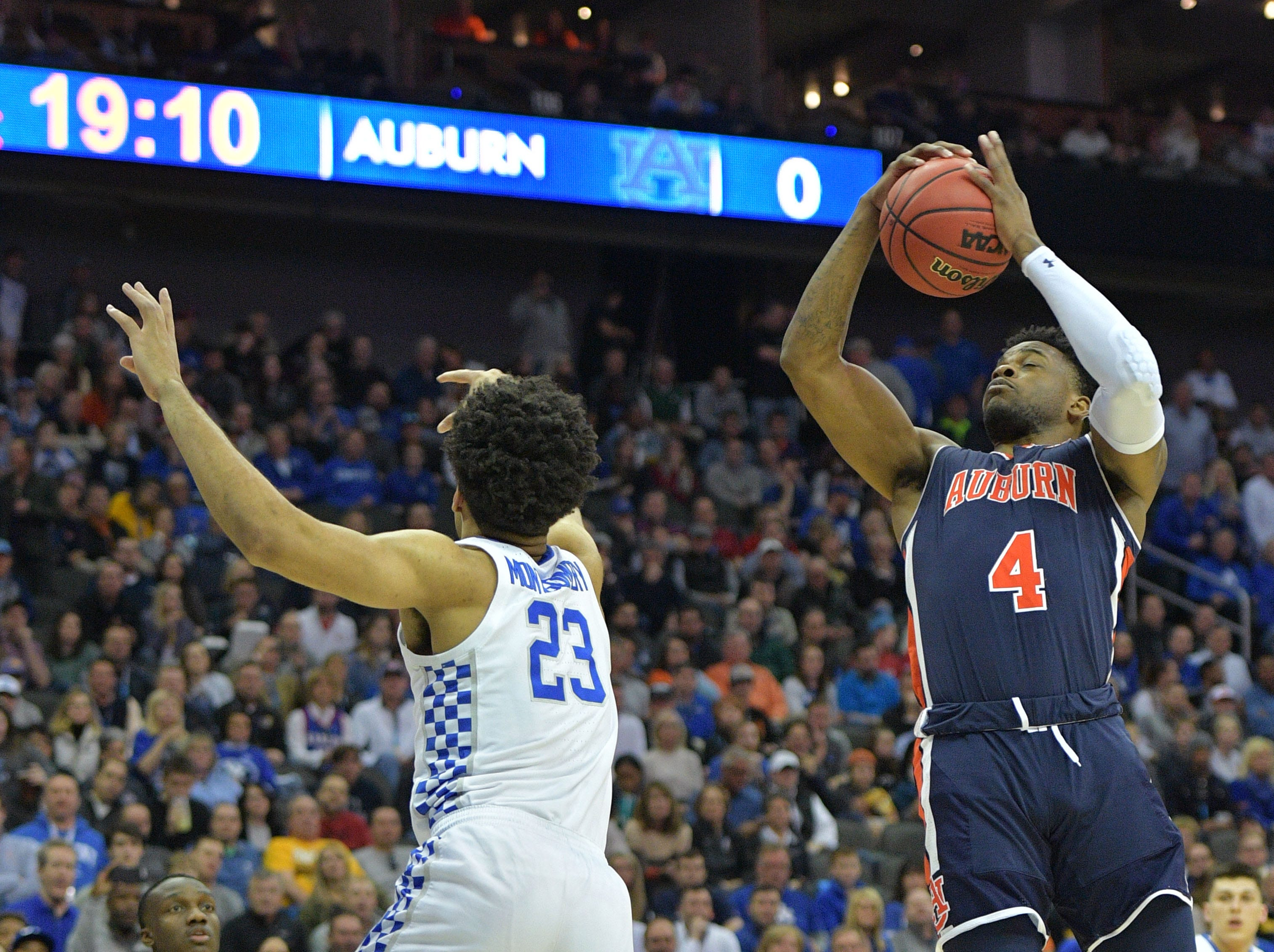 Mar 31, 2019; Kansas City, MO, United States; Auburn Tigers guard Malik Dunbar (4) rebounds over Kentucky Wildcats forward EJ Montgomery (23) during the first half in the championship game of the midwest regional of the 2019 NCAA Tournament at Sprint Center. Mandatory Credit: Denny Medley-USA TODAY Sports
