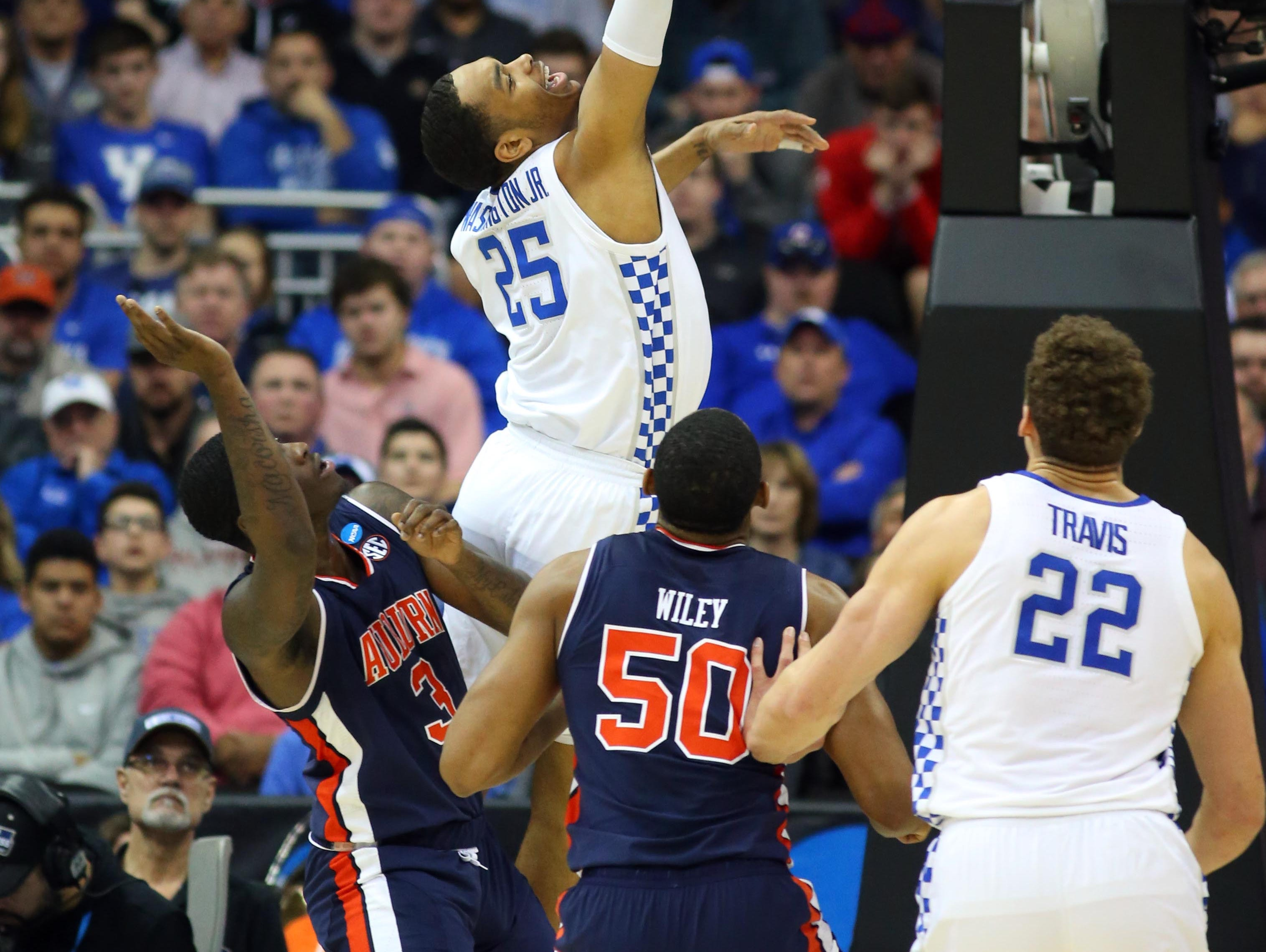 Mar 31, 2019; Kansas City, MO, United States; Kentucky Wildcats forward PJ Washington (25) shoots over Auburn Tigers forward Danjel Purifoy (3) and center Austin Wiley (50) during the first half in the championship game of the midwest regional of the 2019 NCAA Tournament at Sprint Center. Mandatory Credit: Jay Biggerstaff-USA TODAY Sports