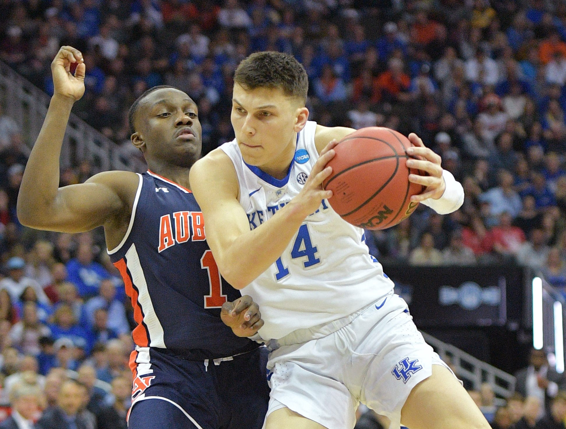 Mar 31, 2019; Kansas City, MO, United States; Kentucky Wildcats guard Tyler Herro (14) drives against Auburn Tigers guard Jared Harper (1) during the first half in the championship game of the midwest regional of the 2019 NCAA Tournament at Sprint Center. Mandatory Credit: Denny Medley-USA TODAY Sports