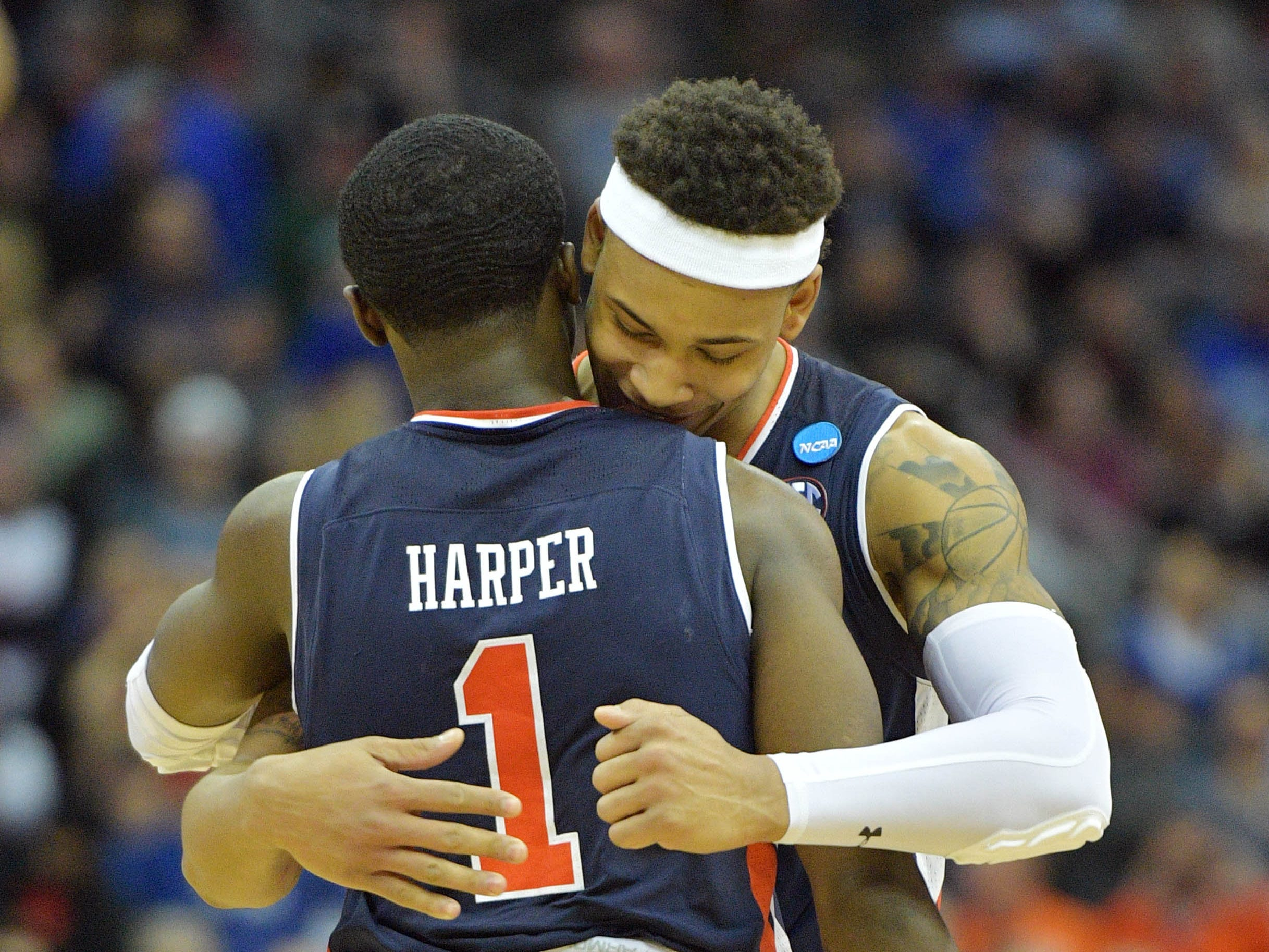 Mar 31, 2019; Kansas City, MO, United States; Auburn Tigers guard Bryce Brown (2) and guard Jared Harper (1) hug against the Kentucky Wildcats during overtime in the championship game of the midwest regional of the 2019 NCAA Tournament at Sprint Center. Mandatory Credit: Denny Medley-USA TODAY Sports
