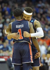 Auburn Tigers guard Bryce Brown (2) and guard Jared Harper (1) hug against the Kentucky Wildcats during overtime in the championship game of the midwest regional of the 2019 NCAA Tournament at Sprint Center.