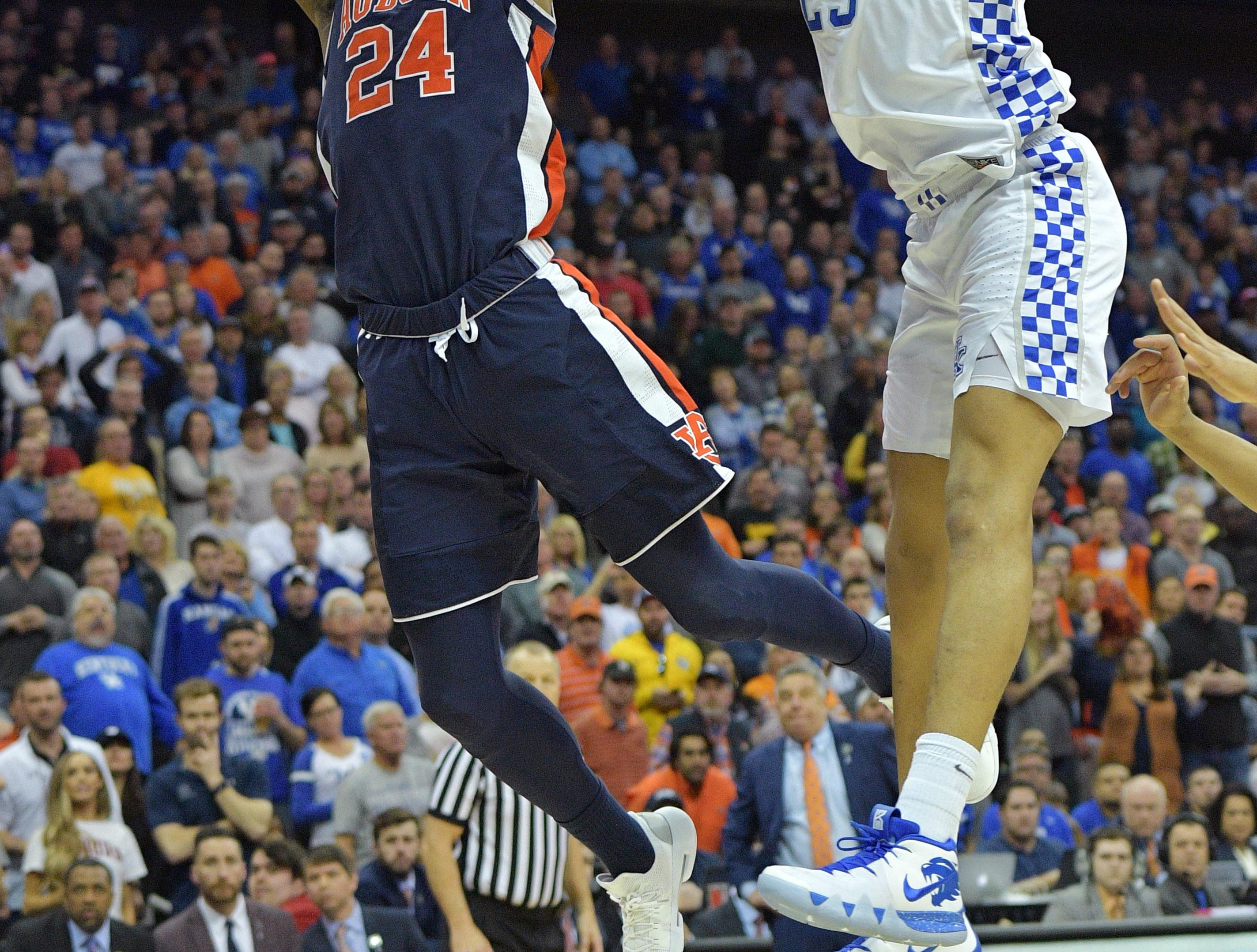Mar 31, 2019; Kansas City, MO, United States; Auburn Tigers forward Anfernee McLemore (24) shoots against Kentucky Wildcats forward PJ Washington (25) during the second half in the championship game of the midwest regional of the 2019 NCAA Tournament at Sprint Center. Mandatory Credit: Denny Medley-USA TODAY Sports