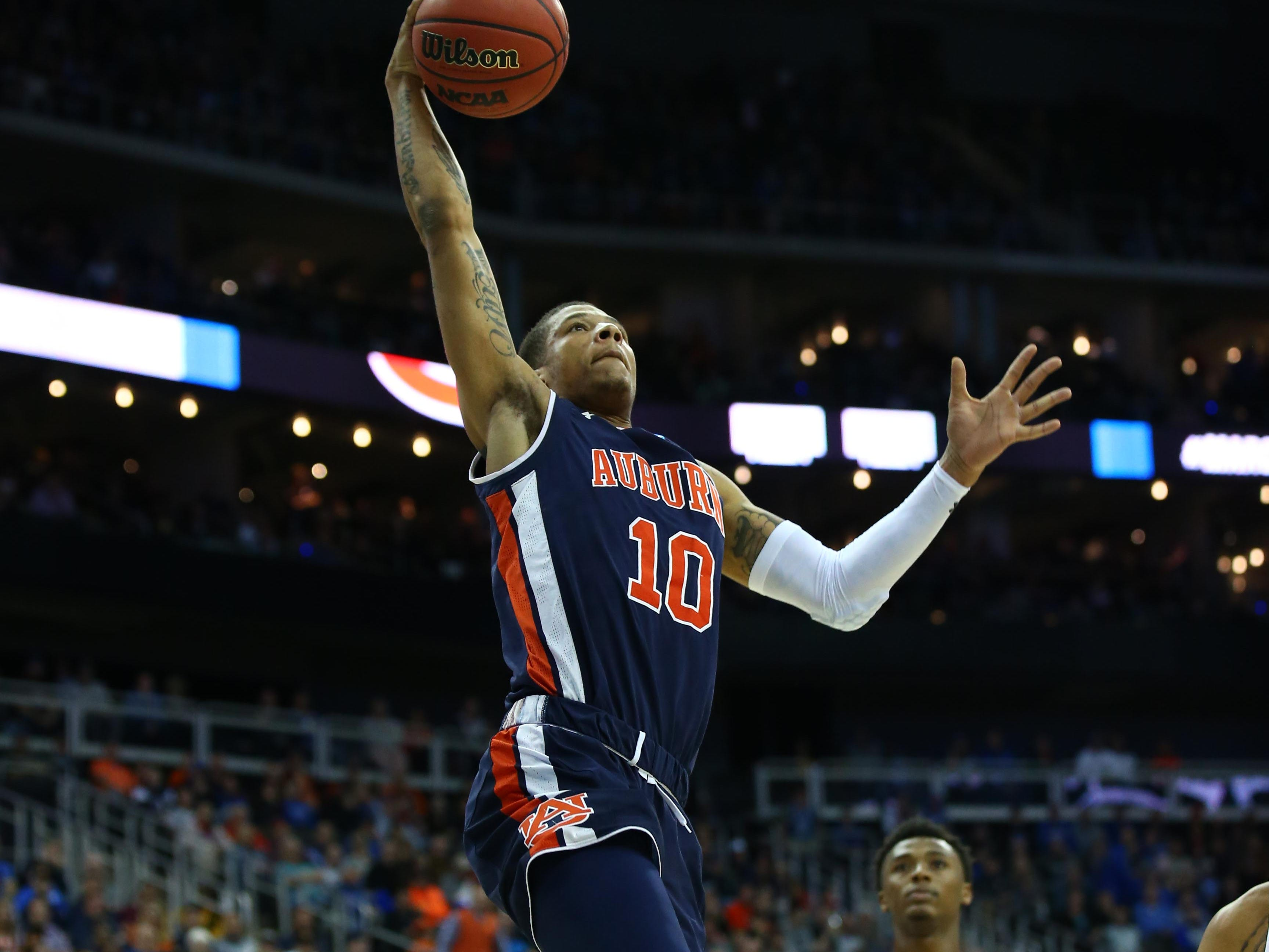 Mar 31, 2019; Kansas City, MO, United States; Auburn Tigers guard Samir Doughty (10) shoots against the Kentucky Wildcats during the first half in the championship game of the midwest regional of the 2019 NCAA Tournament at Sprint Center. Mandatory Credit: Jay Biggerstaff-USA TODAY Sports