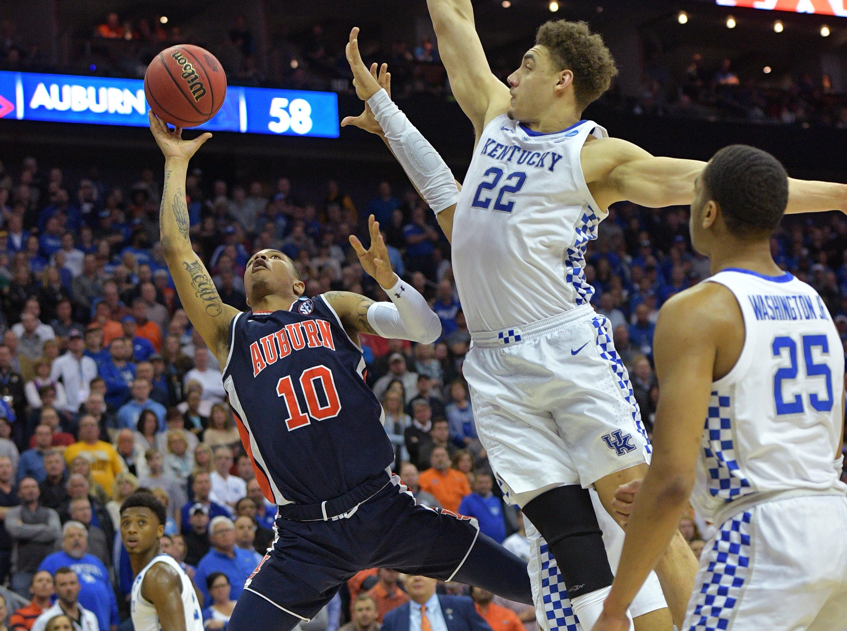 Mar 31, 2019; Kansas City, MO, United States; Auburn Tigers guard Samir Doughty (10) shoots against Kentucky Wildcats forward Reid Travis (22) during the second half in the championship game of the midwest regional of the 2019 NCAA Tournament at Sprint Center. Mandatory Credit: Denny Medley-USA TODAY Sports